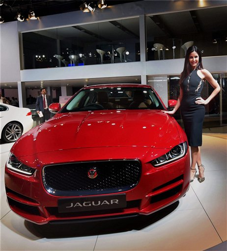 Actress Katrina Kaif poses with a Jaguar Land Rover at Auto Expo 2016 in Greater Noida. Jaguar launched the XE in India at the expo. PTI