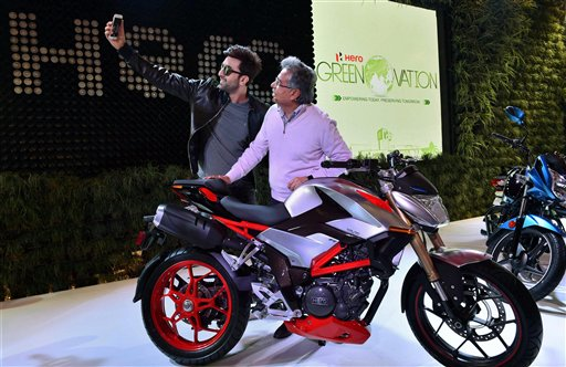 Actor Ranbir Kapoor clicks a selfie with a Hero official at the launch of Hero's new motorcycle at Auto Expo 2016 in Greater Noida. PTI