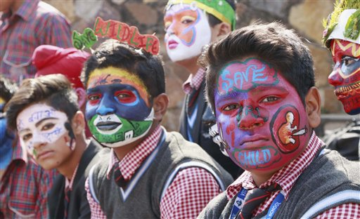 Participants in a face-painting competition with 'Save Girl Child' as its theme at 30th Surajkund International Crafts Mela 2016 in Faridabad. PTI
