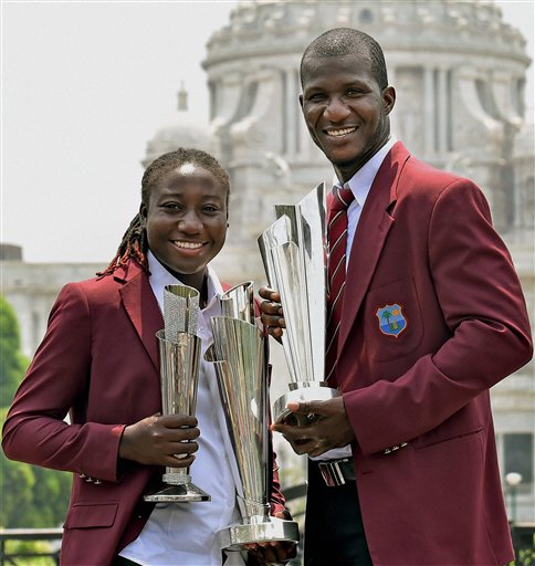 West Indies Captain Darren Sammy and Women Team Captain Stafanie Taylor poses with their respective ICC T20 World Cup Trophies in front of Victoria Memorial in Kolkata. PTI