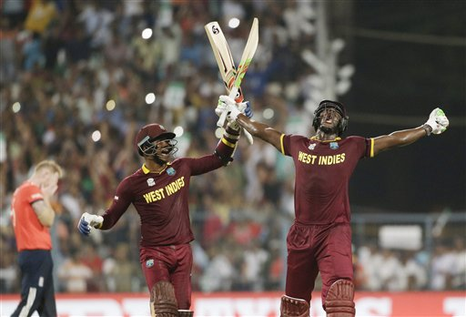 West Indies Carlos Brathwaite (R) celebrates with teammate Marlon Samuels after beating England during the ICC World T20 final match at the Eden Gardens in Kolkata. PTI