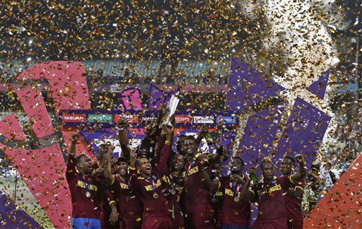 The West Indies team celebrates with their trophy on the podium after defeating England in the final of the ICC World Twenty20 2016 cricket tournament at Eden Gardens in Kolkata. AP