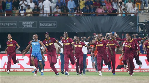 The West Indies team run onto the pitch to celebrate after defeating England in the final of the final of the ICC World Twenty20 2016 cricket tournament at Eden Gardens in Kolkata. AP