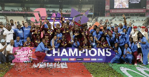 The West Indies men's and women's team pose for a group photo after winning their finals matches of the ICC World Twenty20 2016 cricket tournament at Eden Gardens in Kolkata. AP