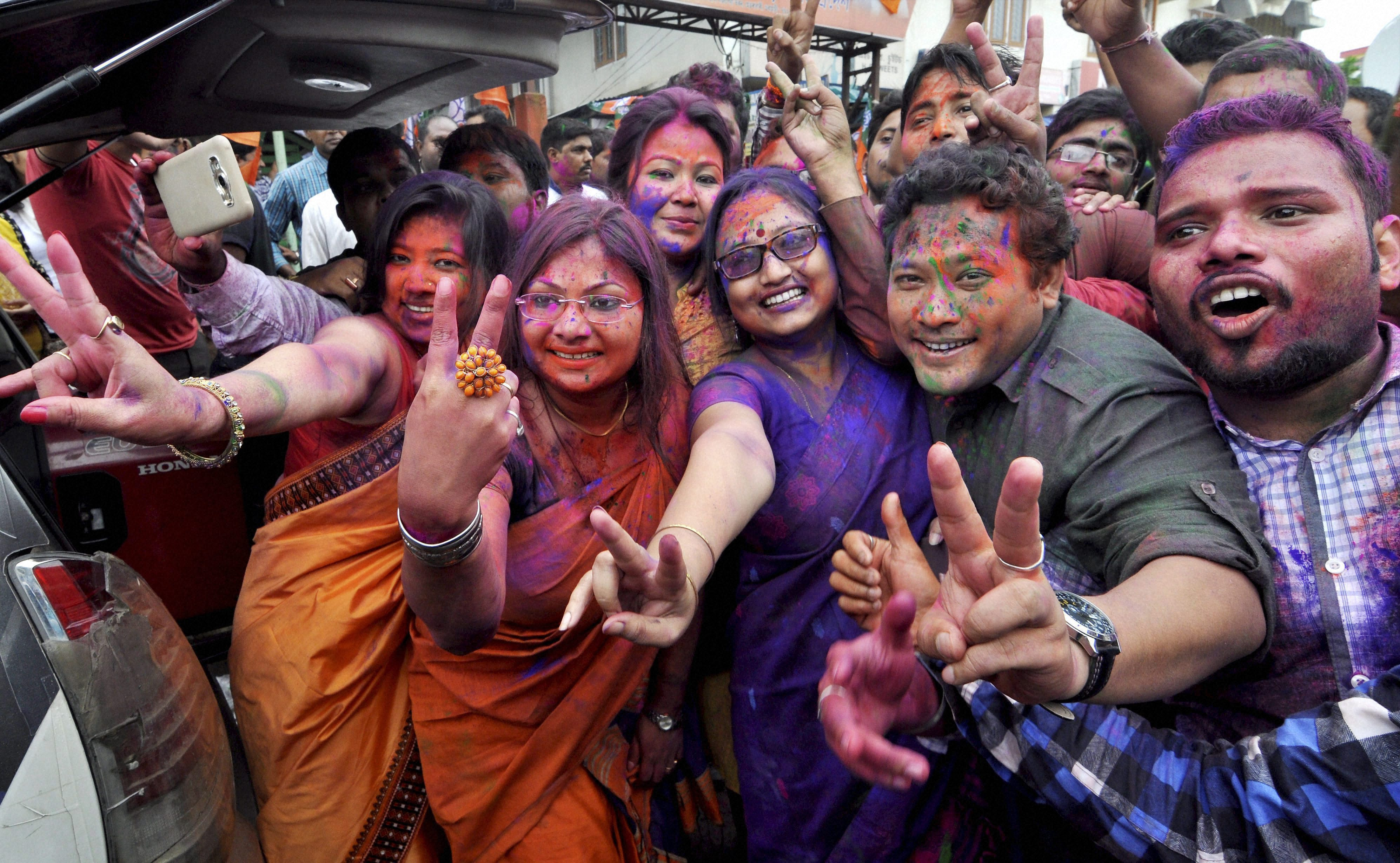 BJP workers dance as they celebrate their win in Assam Assembly election 2016 at Hengrabari in Guwahati on Thursday. PTI