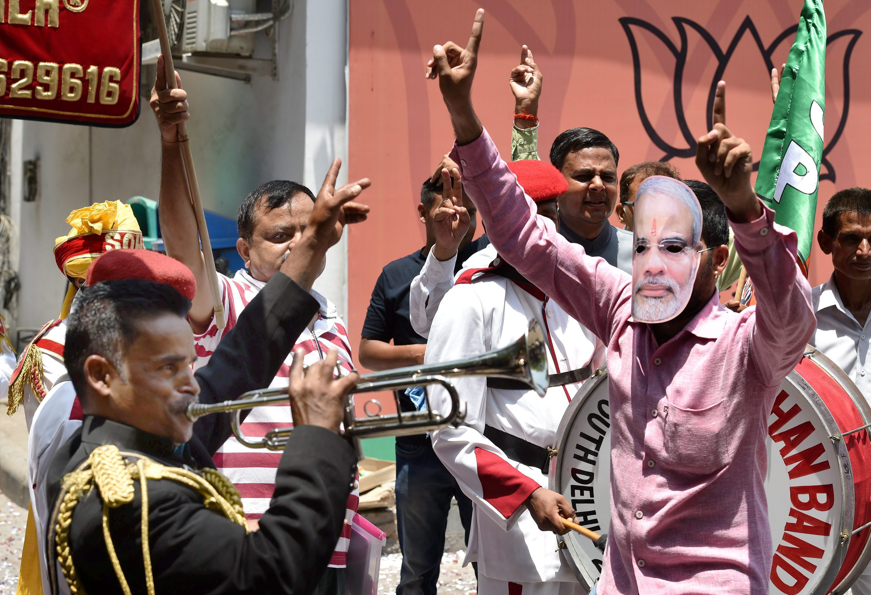 BJP supporters celebrate the party's performance in Assembly polls of the five states, at party headquarters in New Delhi on Thursday. PTI