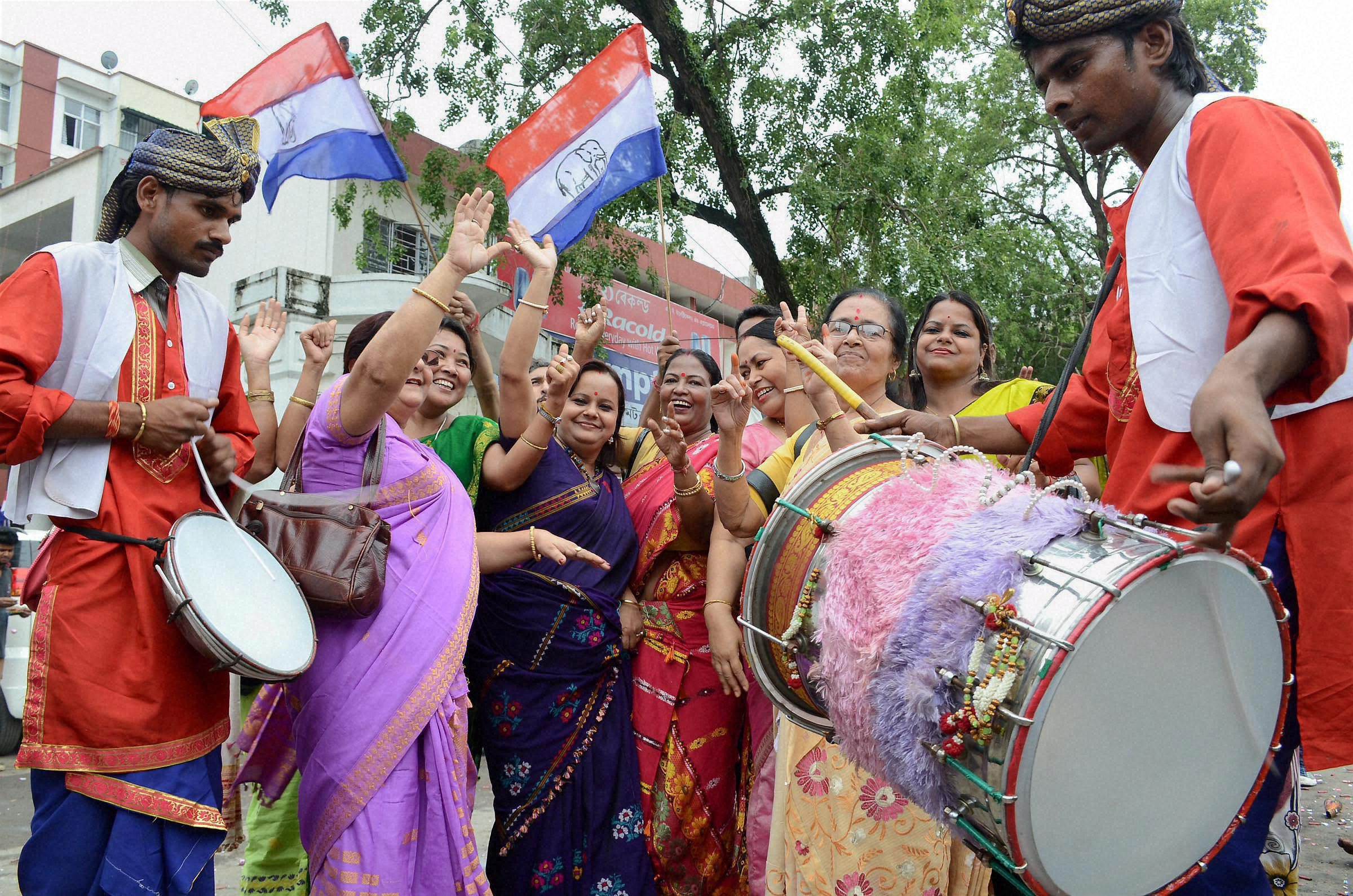 AGP workers celebrate their party's win in Assam Assembly election 2016, in Guwahati on Thursday. PTI