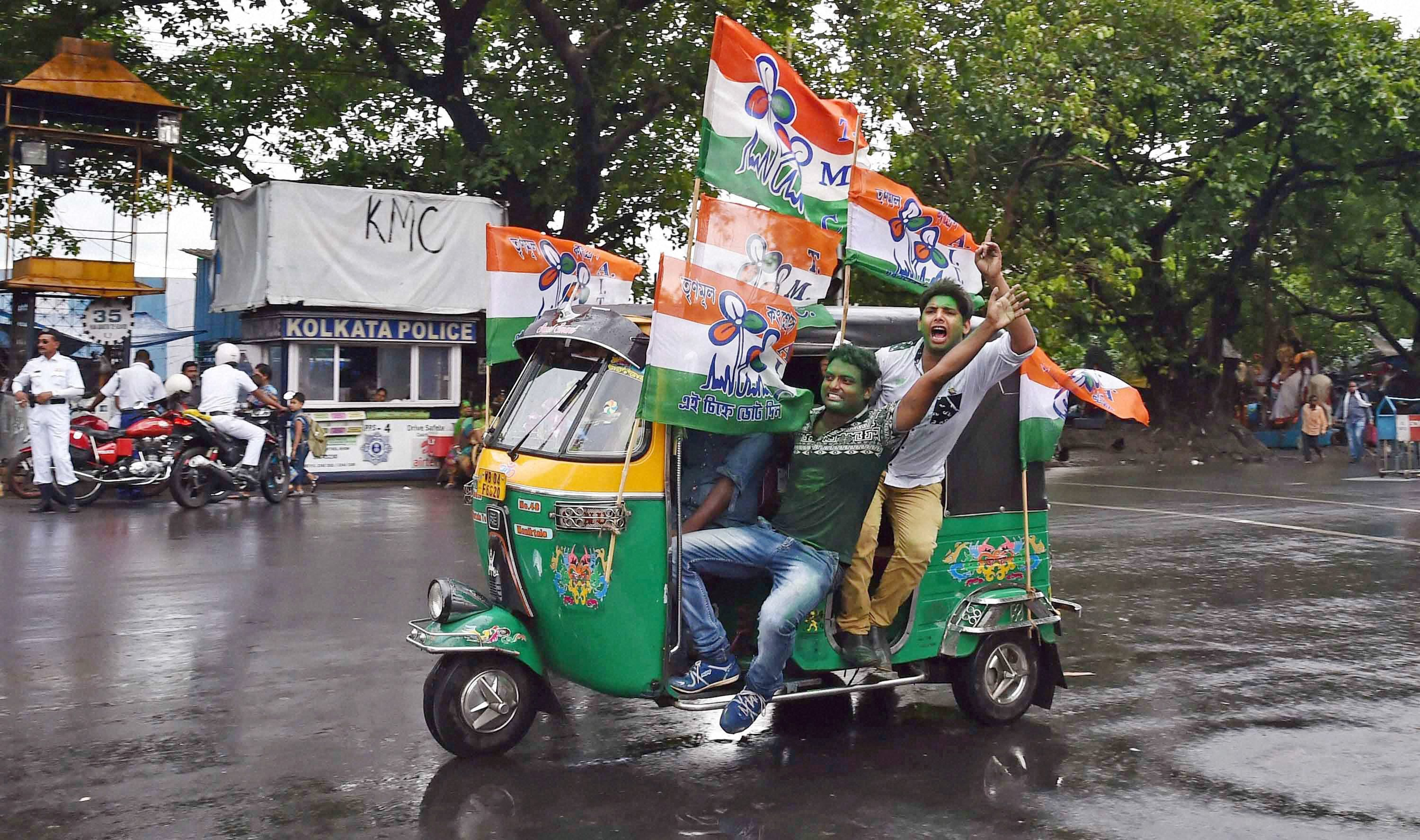 Trinamool Congress supporters celebrate the party's thumping victory in West Bengal Assembly eections in Kolkata on Thursday. PTI