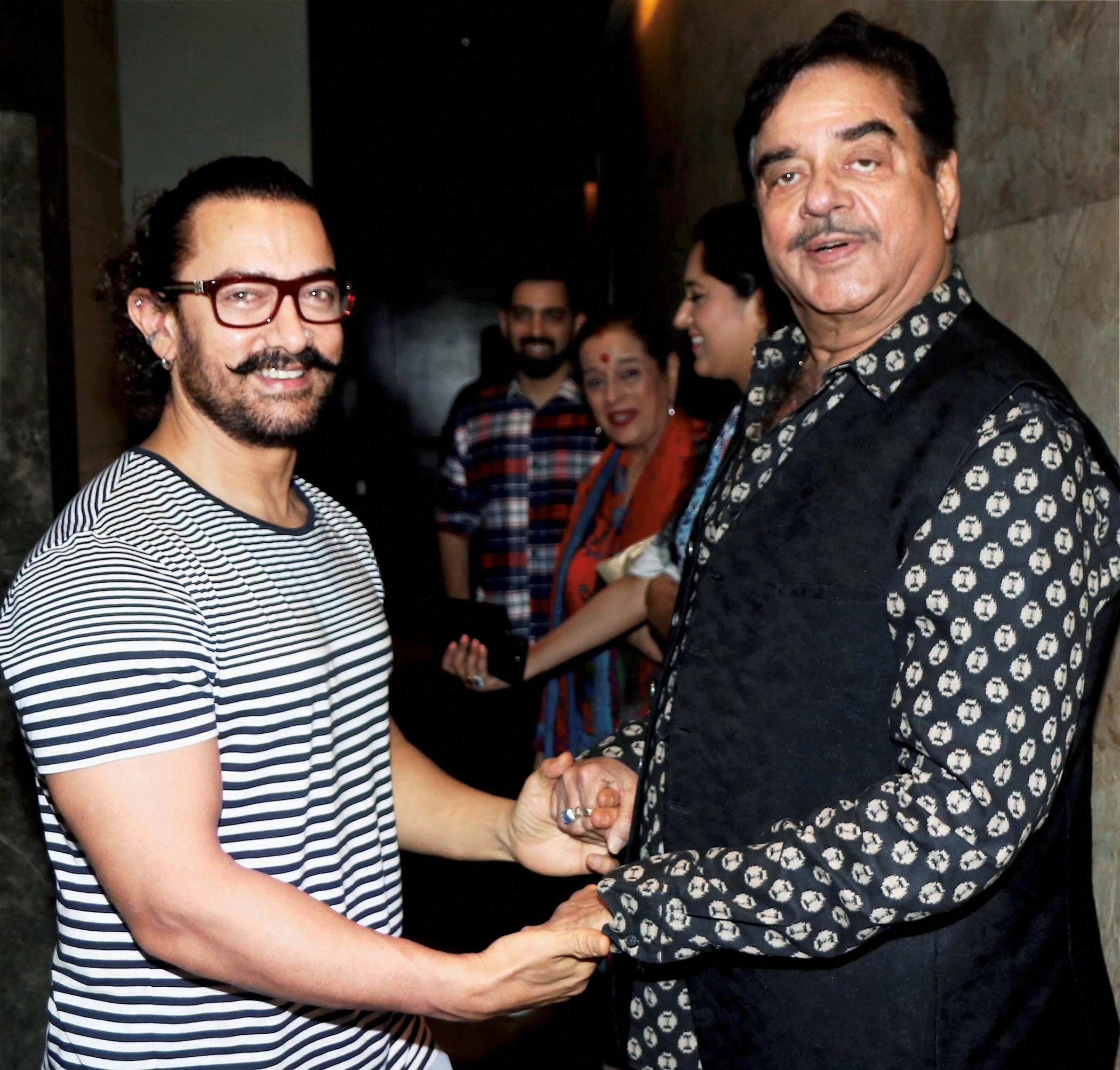 Bollywood actors Aamir Khan (L) and actor-politician Shatrughan Sinha (R) during the special screening of the upcoming musical hindi drama film 'Secret Superstar' in Mumbai- PTI