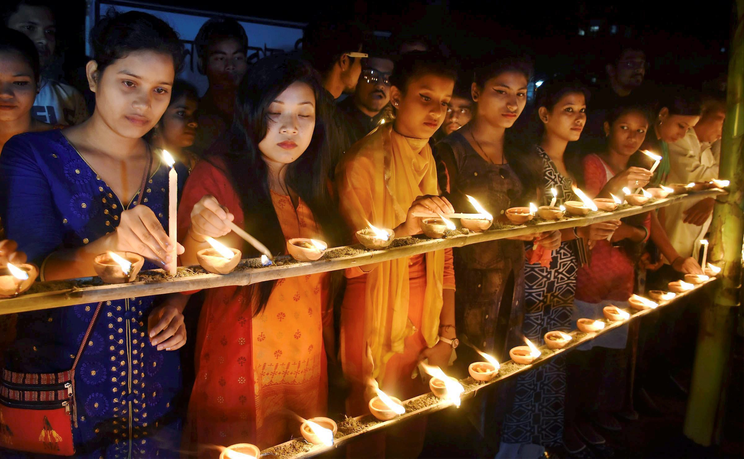 Members of the All Assam Students Union (AASU) lighting earthen lamps at Latasil playground in Guwahati to pay tribute to the victims of the October 30, 2008 serial bomb blast on its ninth anniversary - PTI