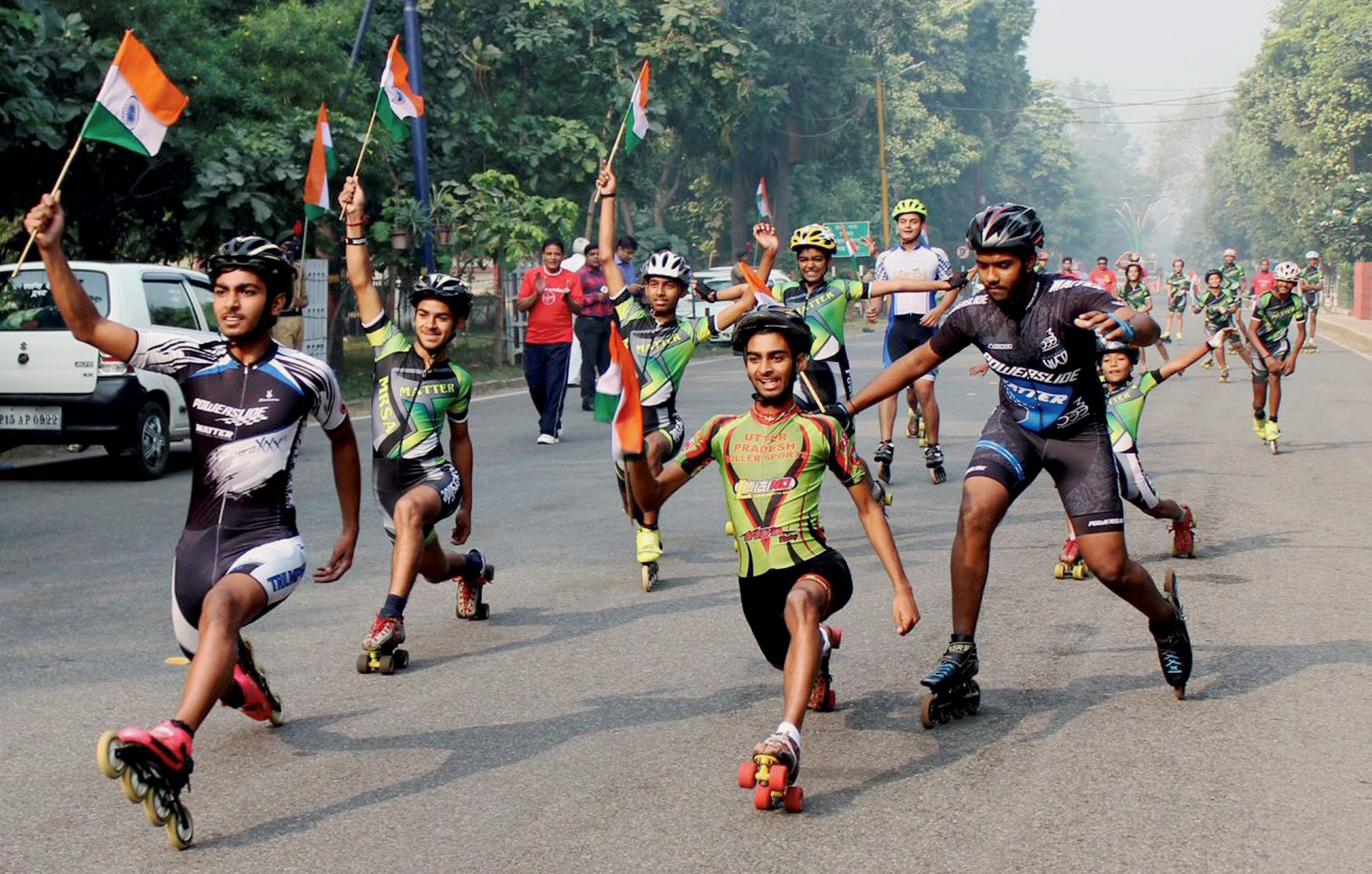 Volunteers take part in a skate rally to create awareness about population control in Meerut - PTI