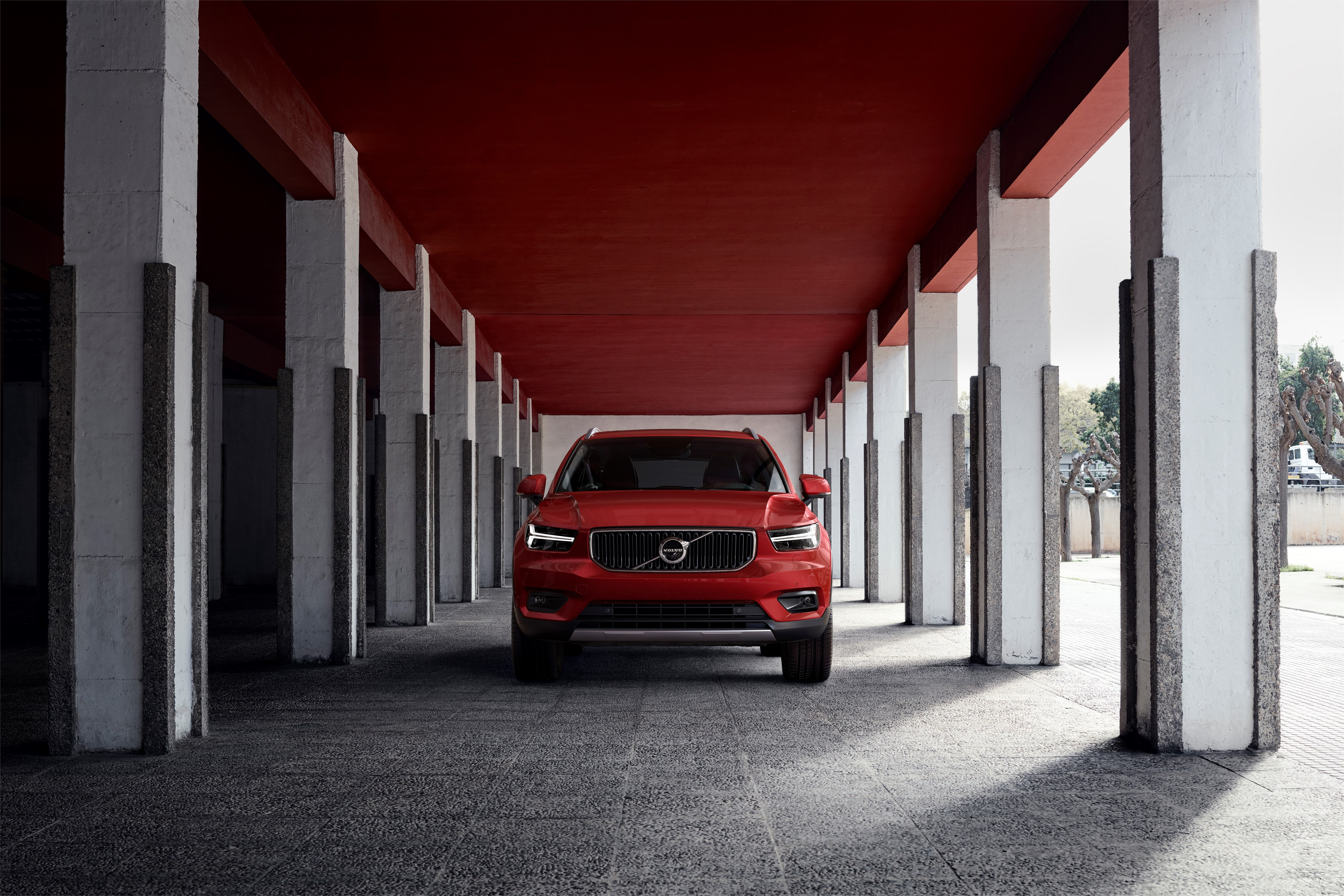 New Volvo XC40 Momentum in Fusion Red - exterior, on location