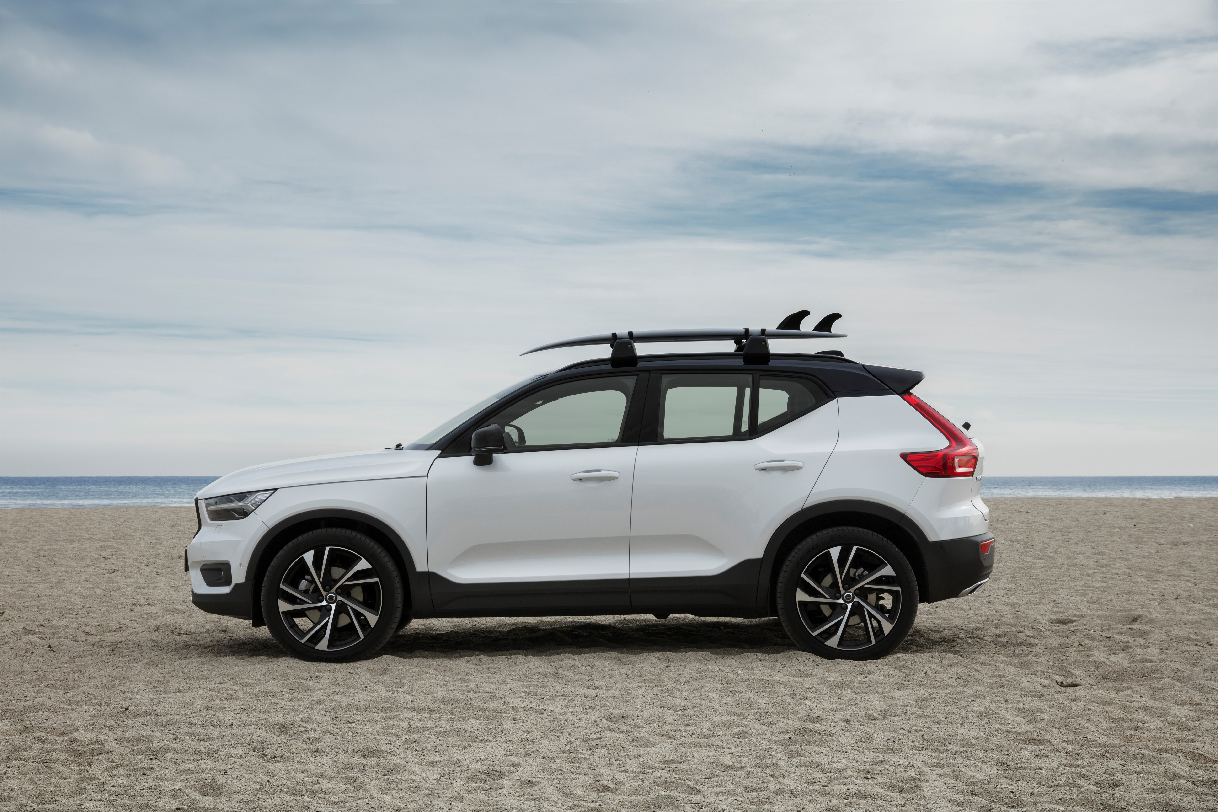 New Volvo XC40 R-Design T5 Crystal White with black roof on location in Barcelona, HAV surfboards