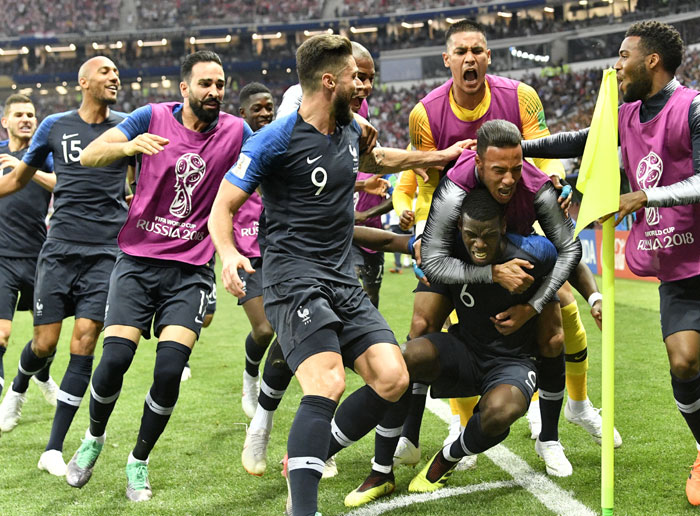 France's Paul Pogba, third from right, celebrates with his teammates after scoring his side's third goal during the final match between France and Croatia at the 2018 soccer World Cup in the Luzhniki Stadium in Moscow - AP