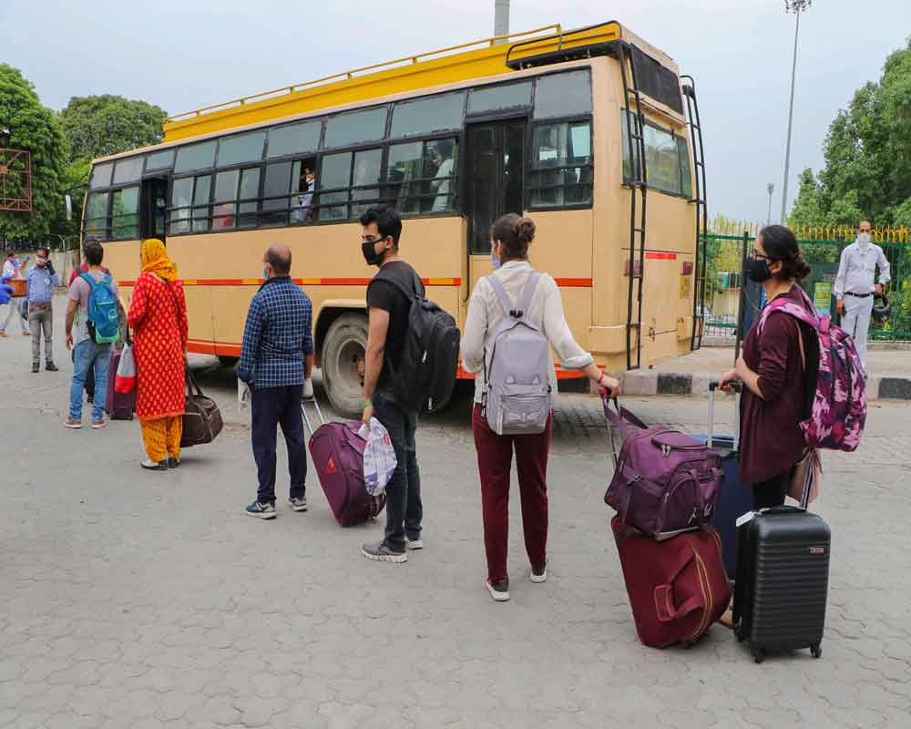 Passengers arrive at Jammu Railway Station following the resumption of passenger train services by Indian Railways connecting major cities, during the ongoing COVID-19 nationwide lockdown, in Jammu - PTI