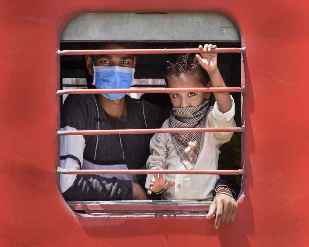 Migrants arrive at Amethi Railway Station by a special train from Ahmedabad, during ongoing COVID-19 lockdown, in Amethi - PTI