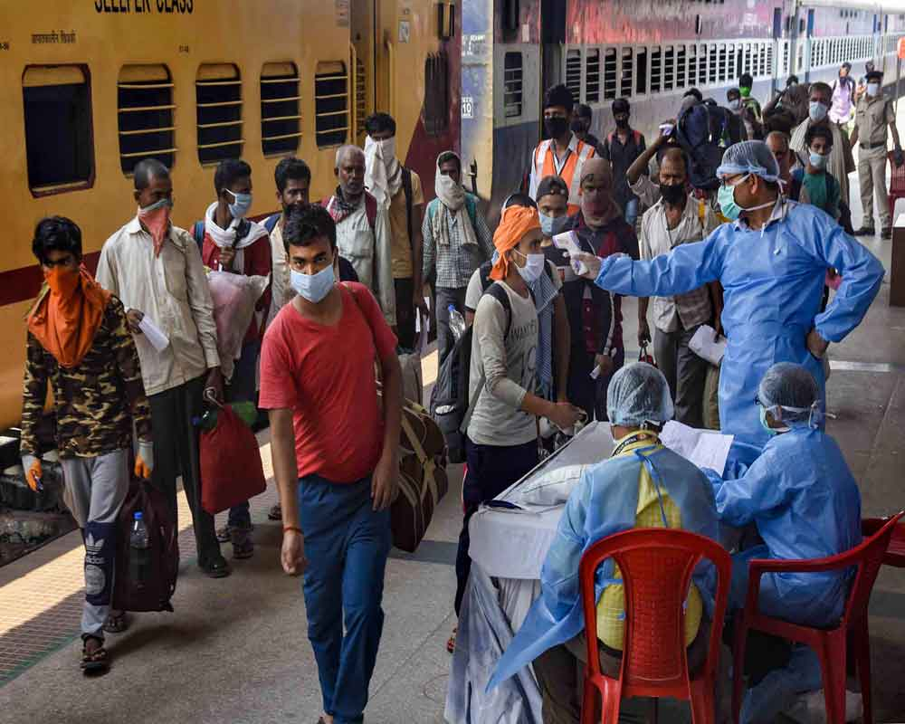 Medics conduct a thermal screening of migrants who have arrived from Haryana by a special train at Danapur Railway station, during the ongoing COVID-19 nationwide lockdown, in Patna - PTI