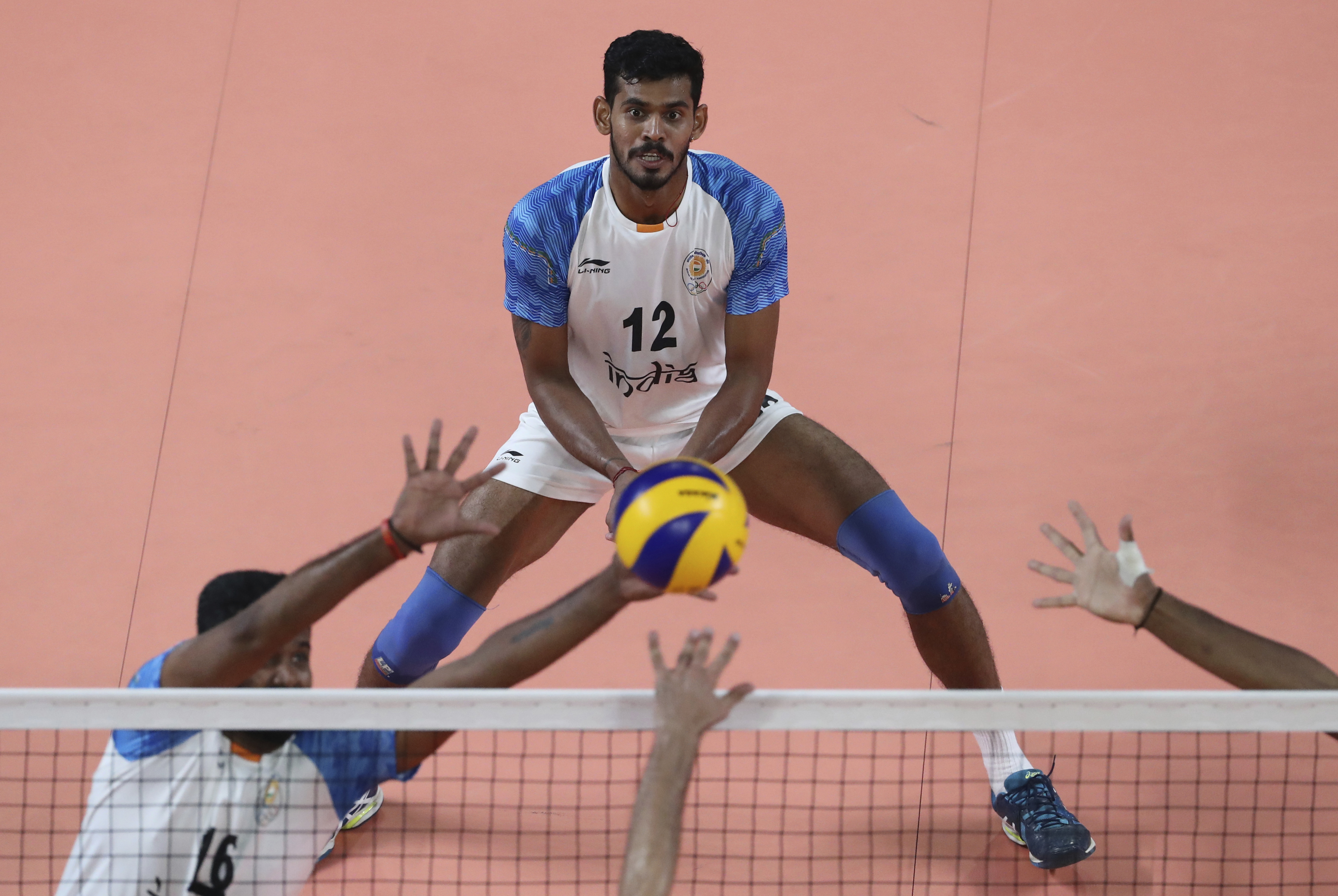Jerome Charles of India, center, plays