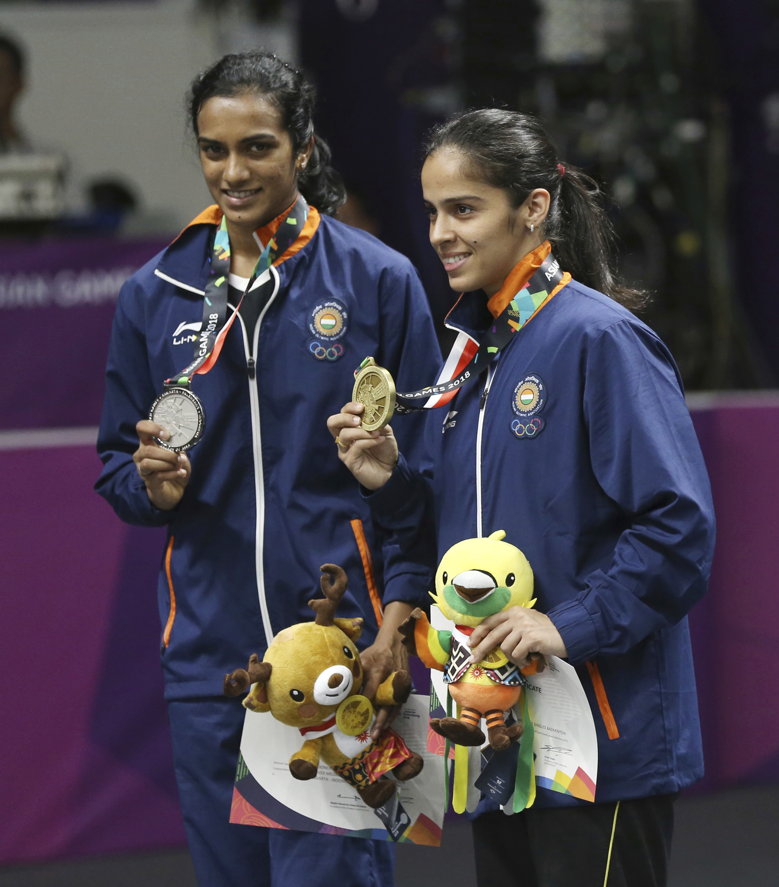 India`s Sindhu Pusarla, left, with her silver