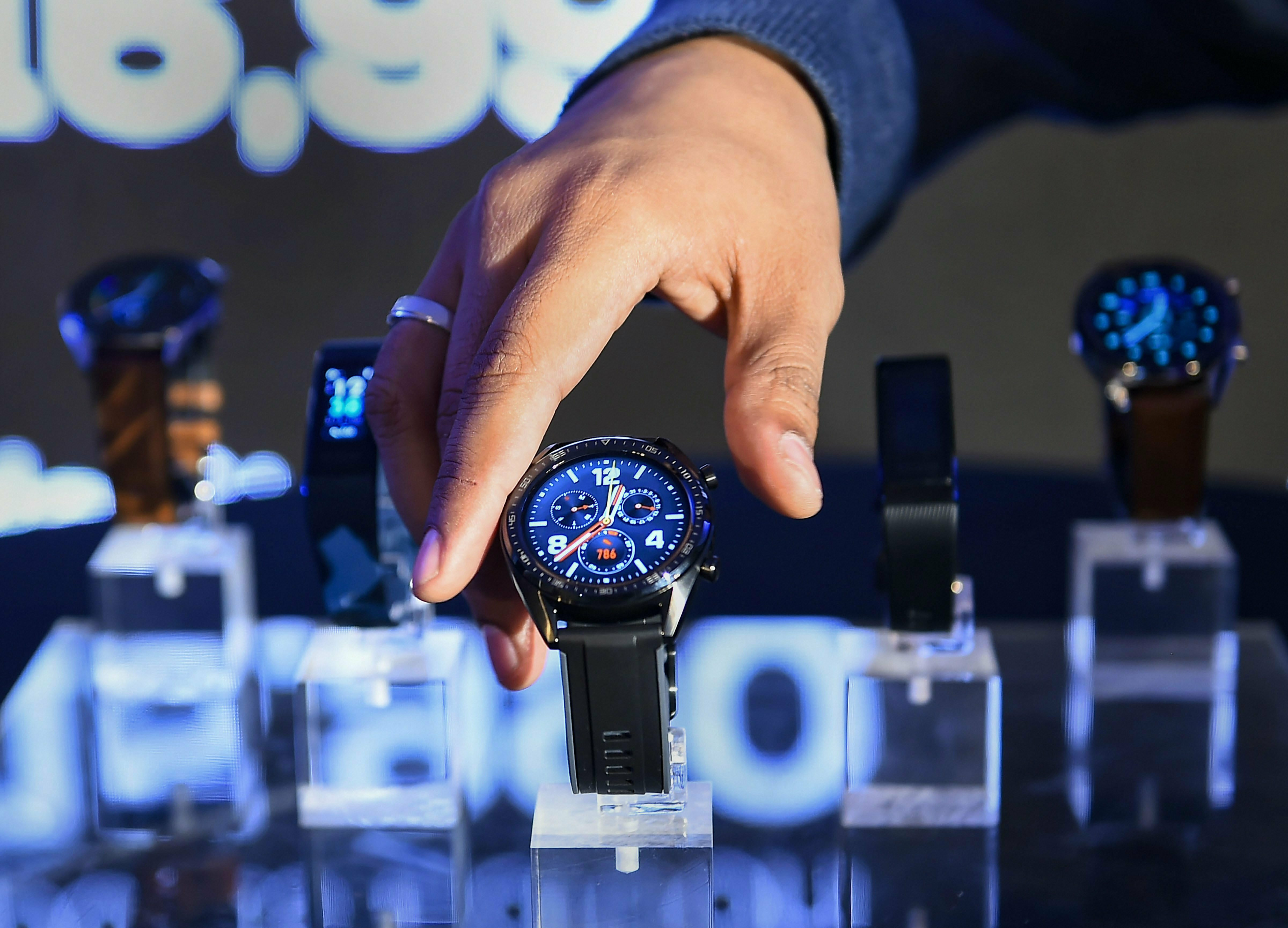 Chinese smartphone manufacturer Huawei's newly-launched Watch GT, Huawei Band 3 Pro and Huawei Band 3e kept on display, in New Delhi - PTI