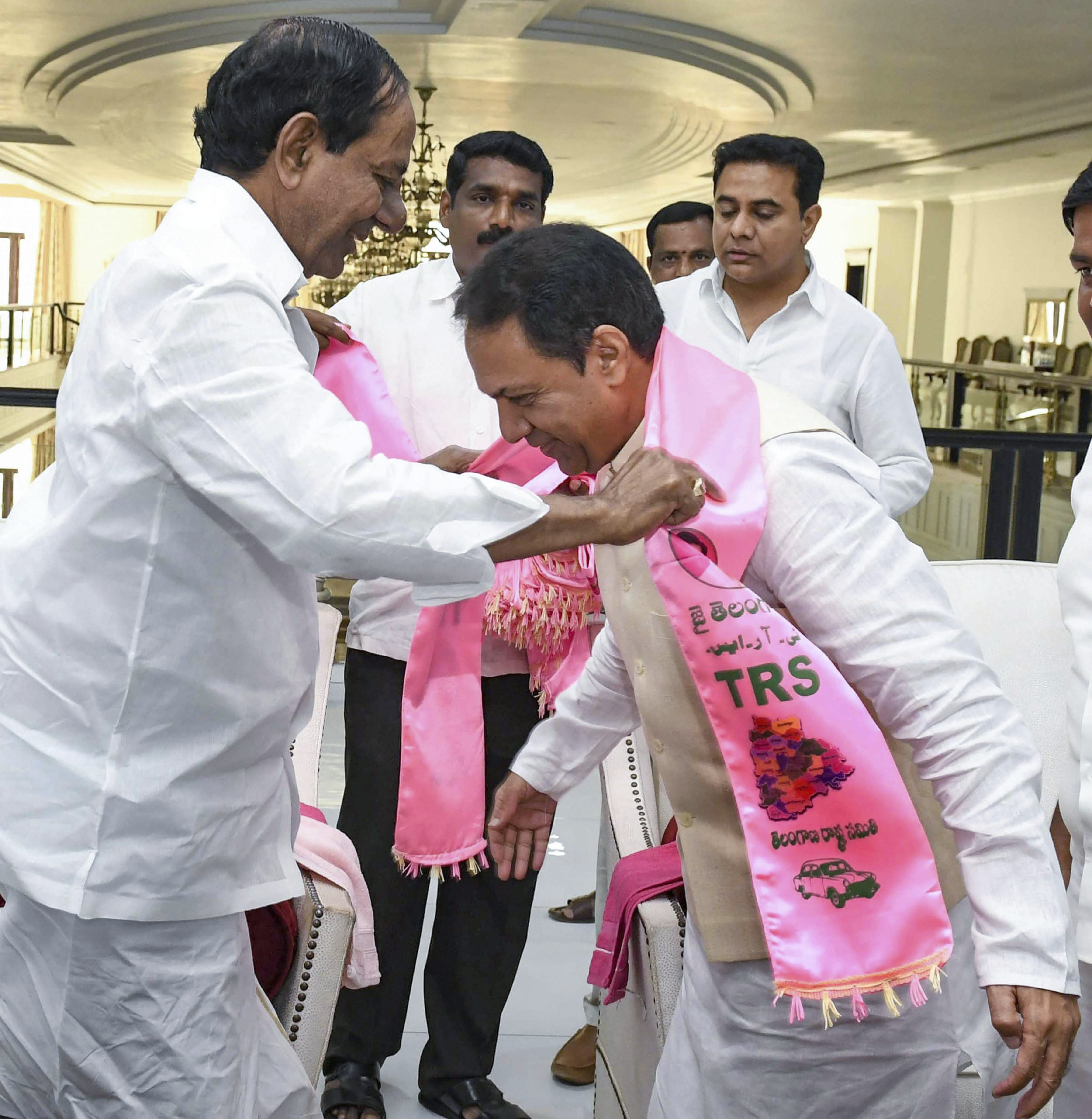 Senior Congress leader Suresh Reddy being welcomed as he joins Telangana Rashtra Samithi (TRS) by party chief K Chandra Shekhar Rao, in Hyderabad - PTI