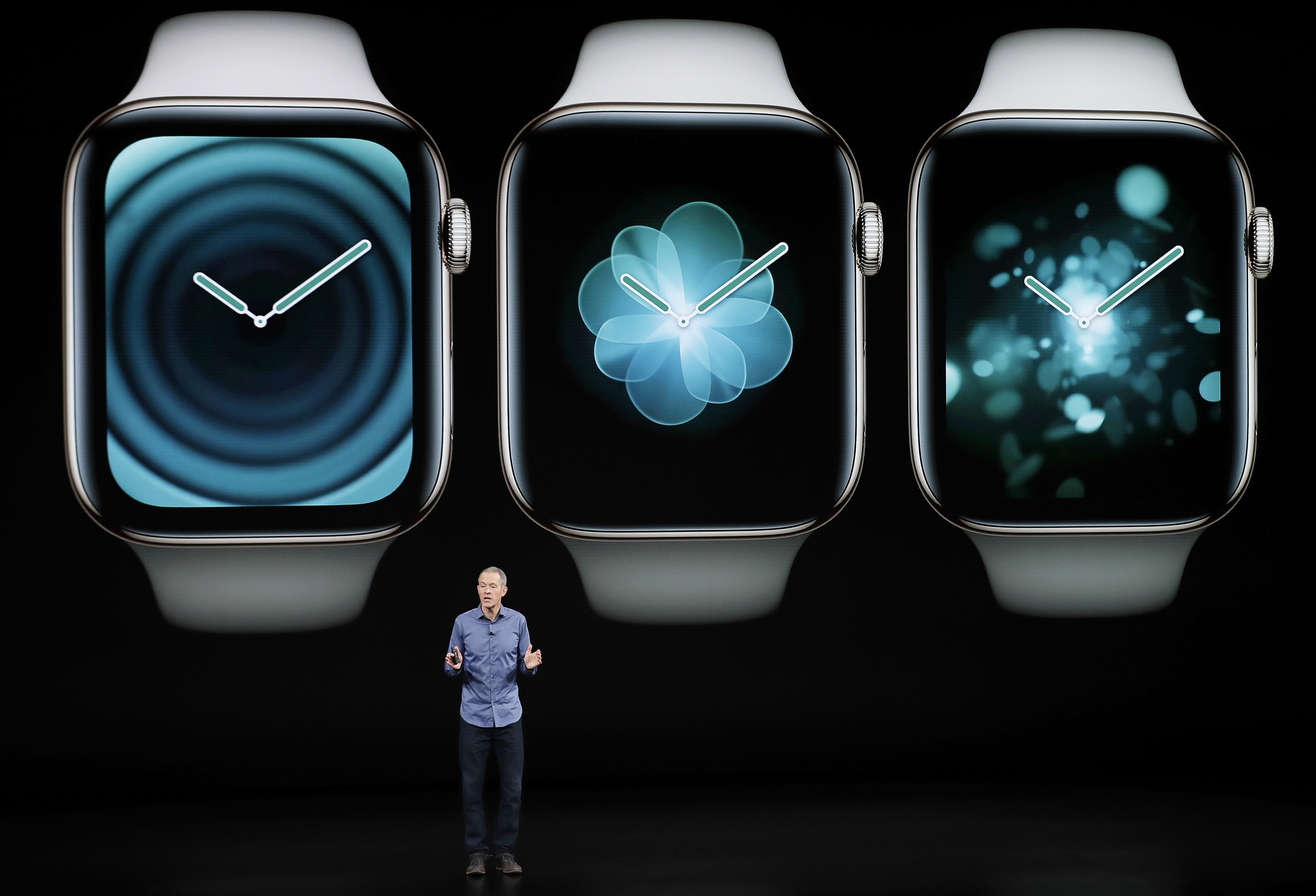 Jeff Williams, Apple's chief operating officer, speaks about the Apple Watch Series 4 at the Steve Jobs Theater during an event to announce new Apple products Wednesday, Sept. 12, 2018, in Cupertino, Calif - AP