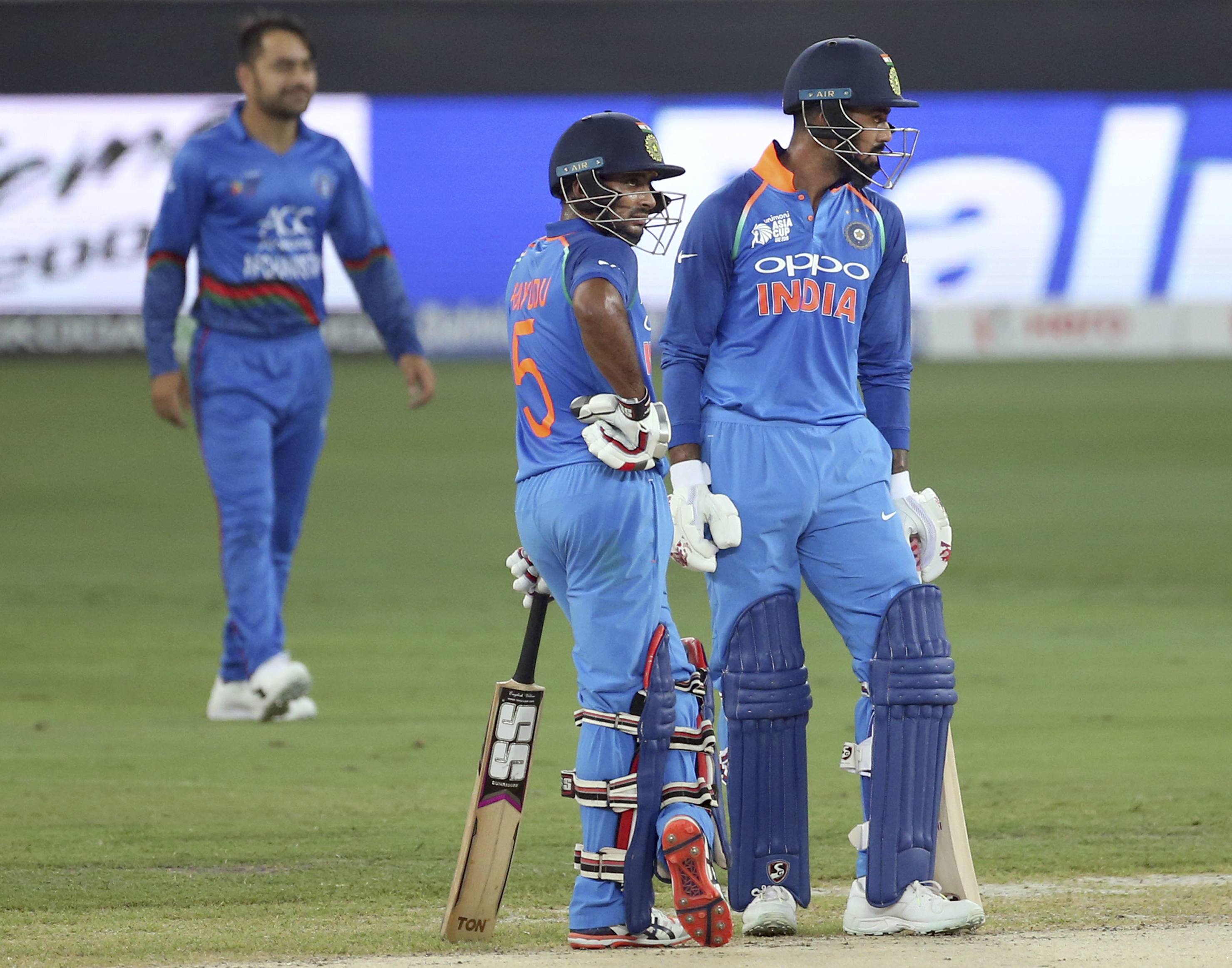 India's Lokesh Rahul, right, and teammate Ambati Rayudu stand together during the one day international cricket match of Asia Cup between India and Afghanistan in Dubai, United Arab Emirates - AP
