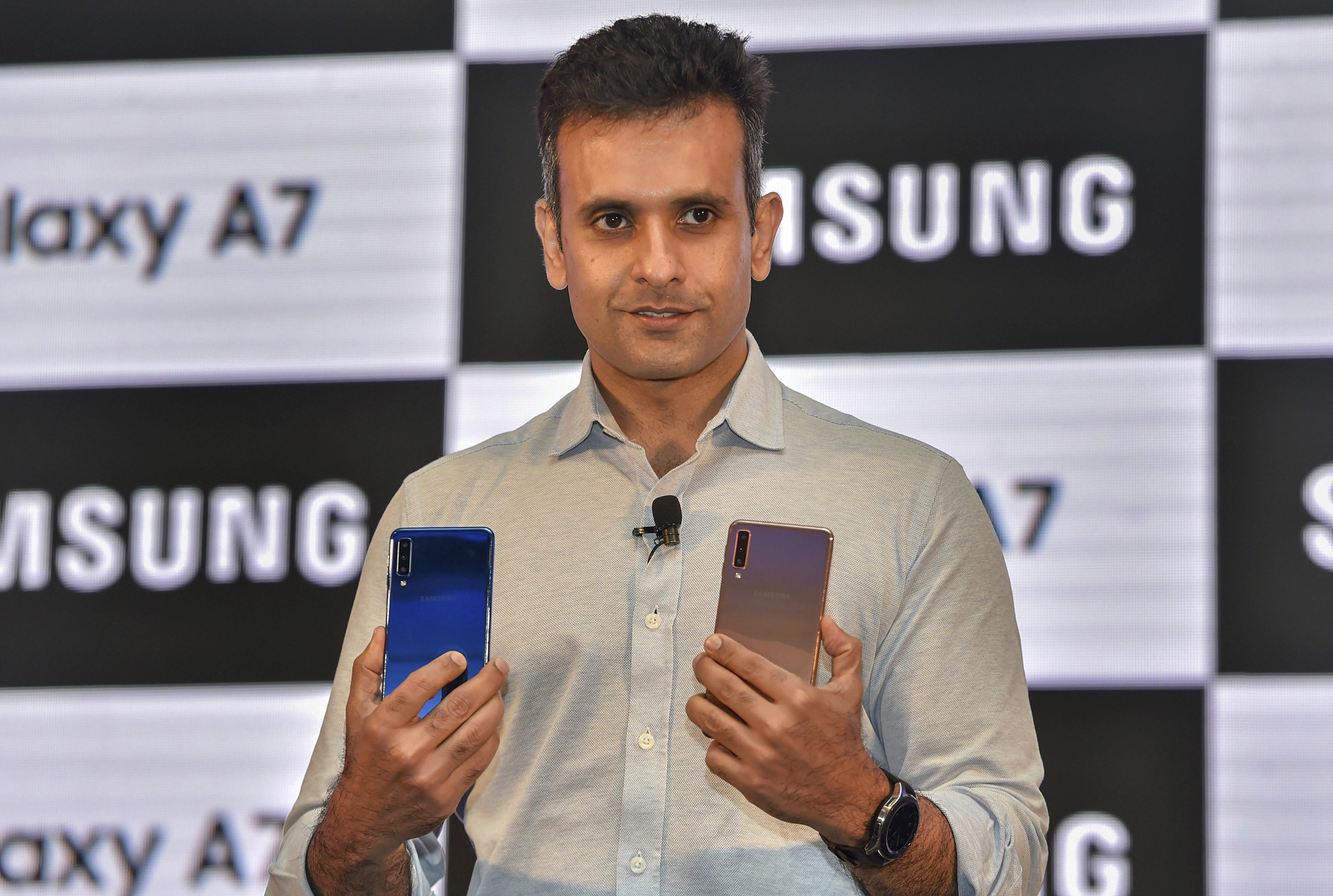 Samsung India Director, Mobile business, Sumit Walia poses for photos during the launch of company's first triple camera smartphone Galaxy A7, in New Delhi - PTI