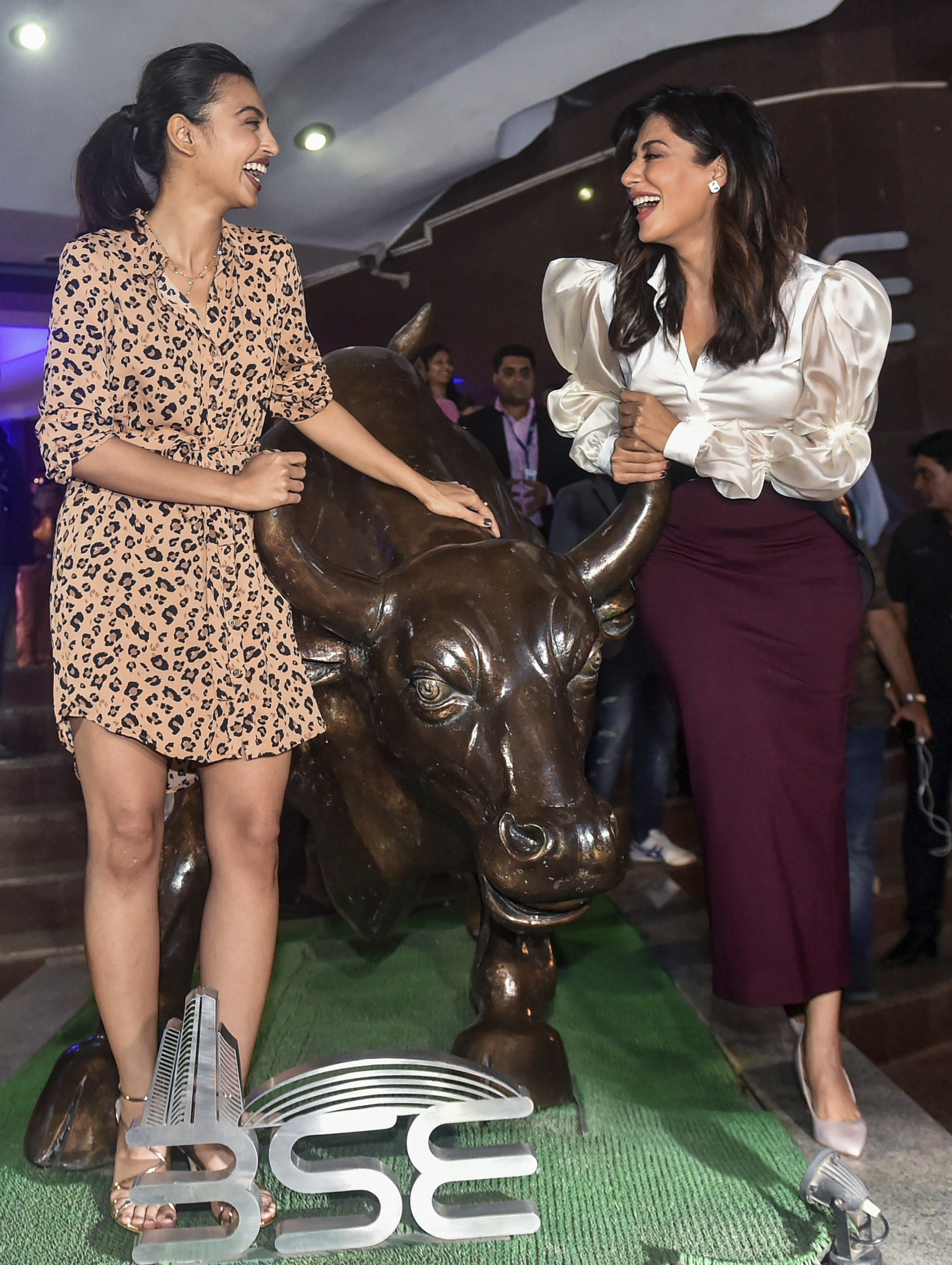 Bollywood actresses Chitrangada Singh and Radhika Apte near the statue of the bull at Bombay Stock Exchange during a promotional event of their movie 'Bazaar' in Mumbai - PTI