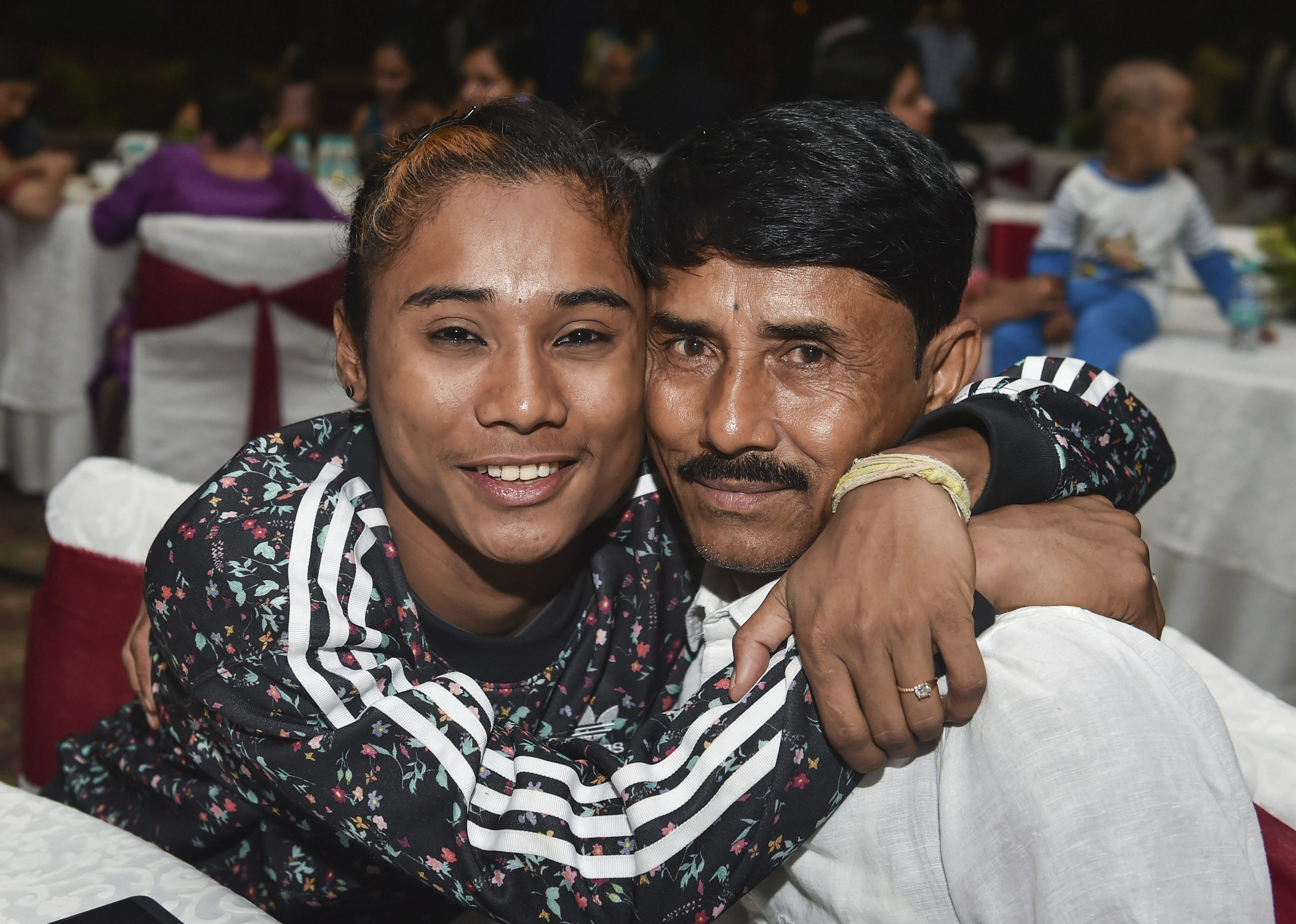 Arjuna awardee athlete Hima Das with her father Ronjit Das during a dinner hosted in the honour of the winners of National Sports and Adventure Awards, in New Delhi - PTI