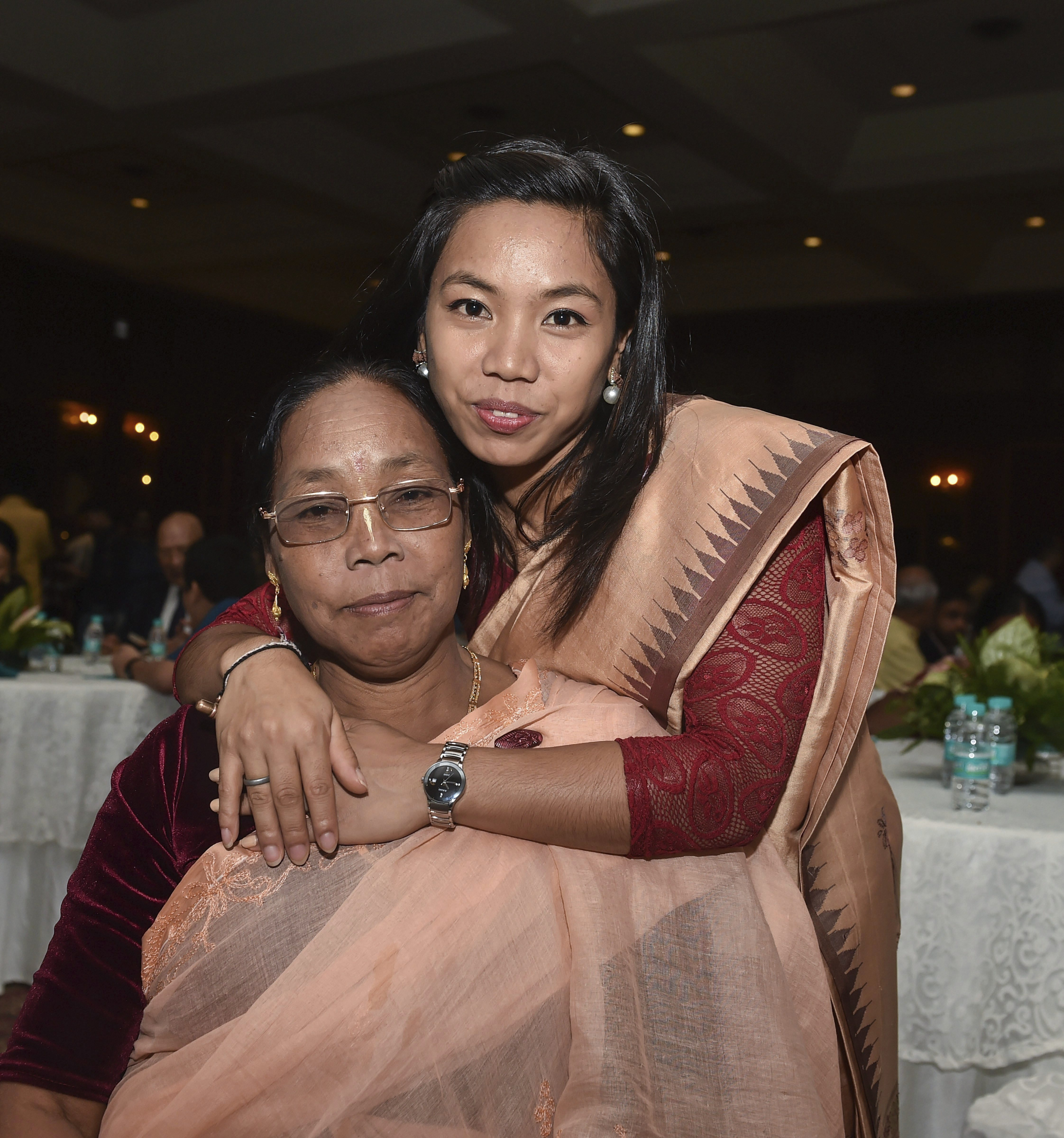 Rajiv Gandhi Khel Ratna awardee Mirabai Chanu with her mother Saikohm Ongbi Tombi Leima during a dinner hosted in the honour of the winners of National Sports and Adventure Awards, in New Delhi - PTI