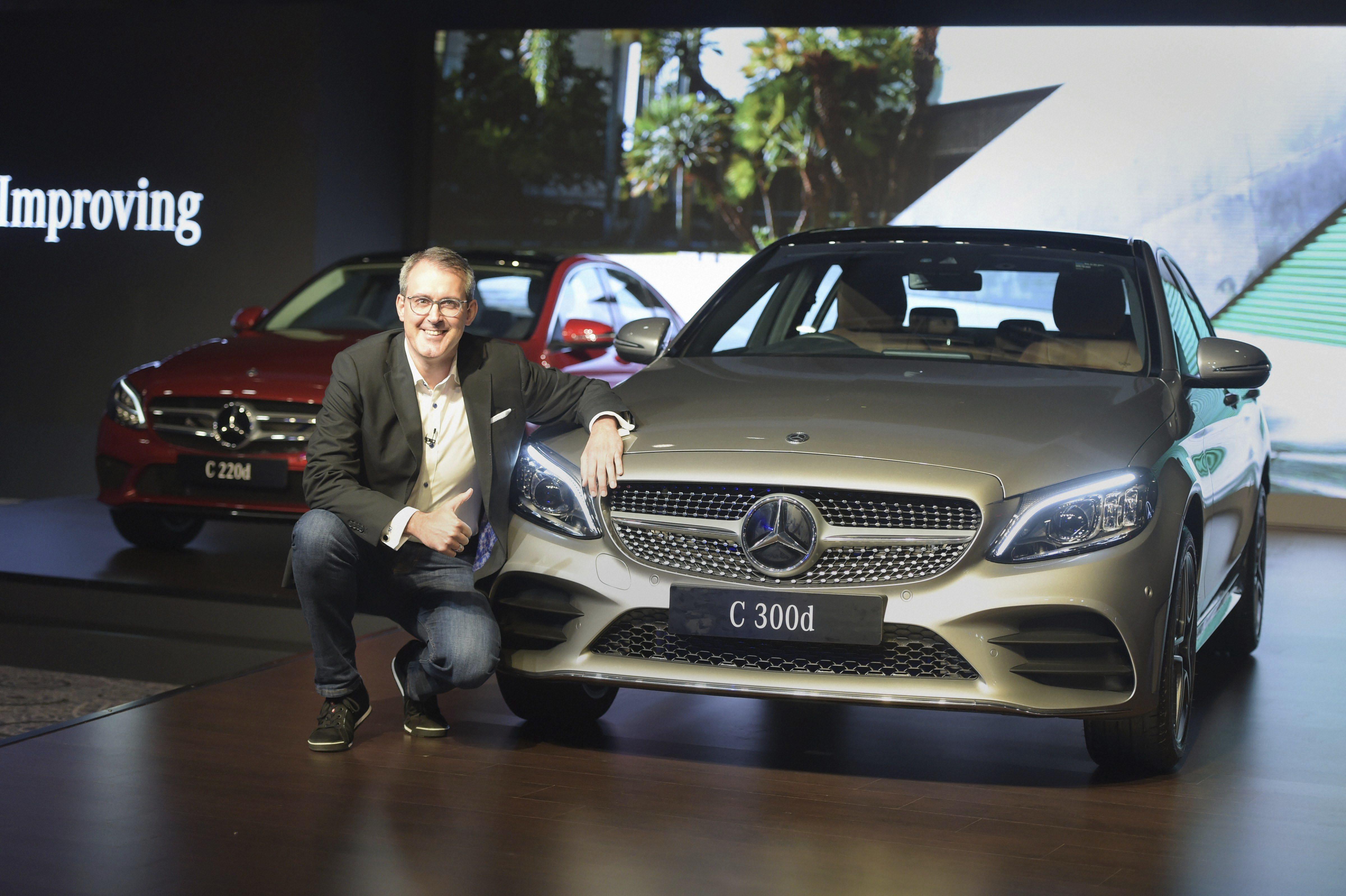 Mercedes-Benz India's Vice President (Sales & Marketing) Michael Jopp poses for photographs at the launch of the C-Class facelift sedans C 300d, C 220d Prime and C 220d Progressive, in New Delhi - PTI