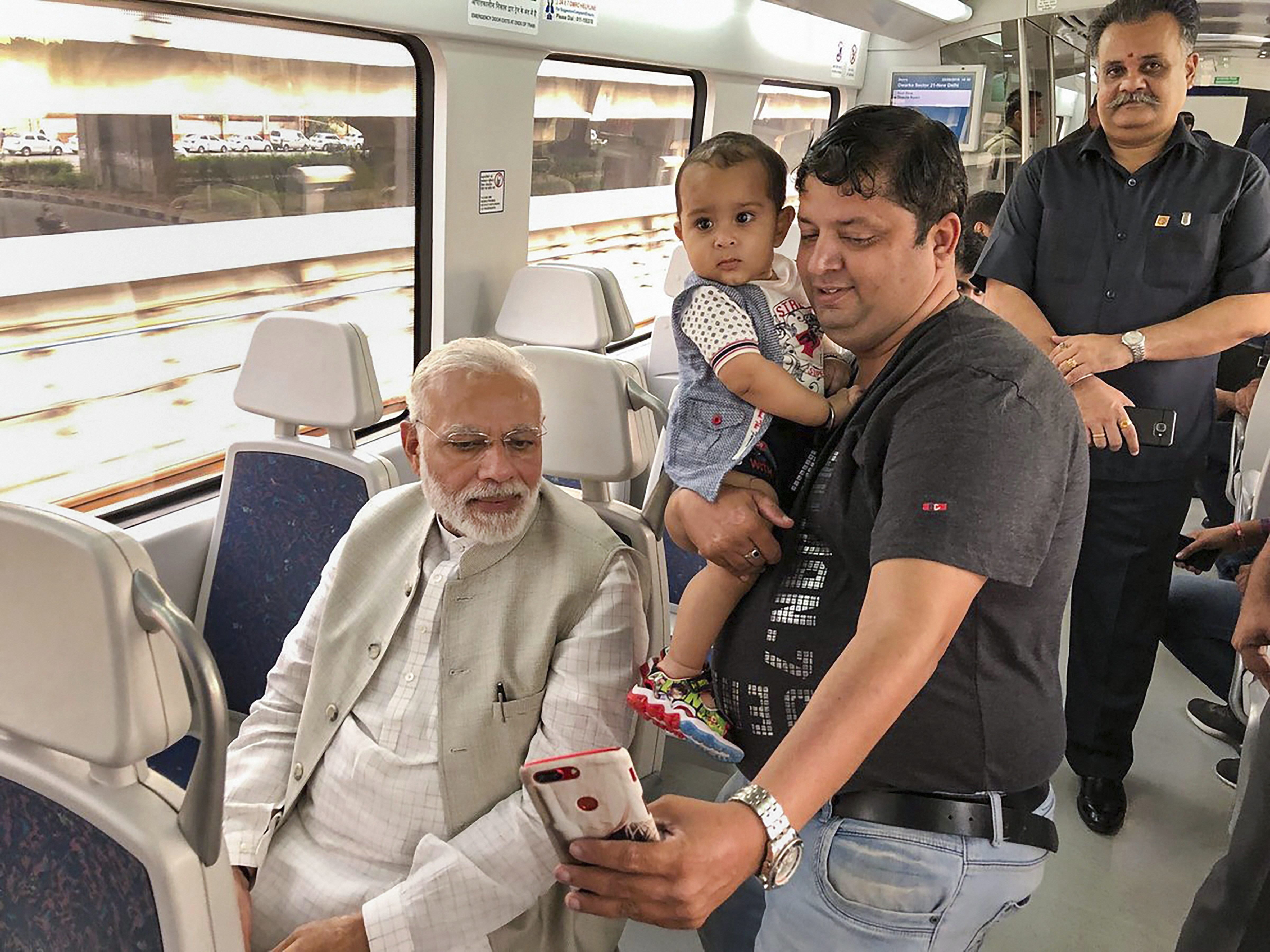 Prime Minister Narendra Modi travels in Airport Express Metro Line to reach the venue of the foundation stone laying ceremony of India International Convention and Expo Centre at Dwarka, in New Delhi - PTI