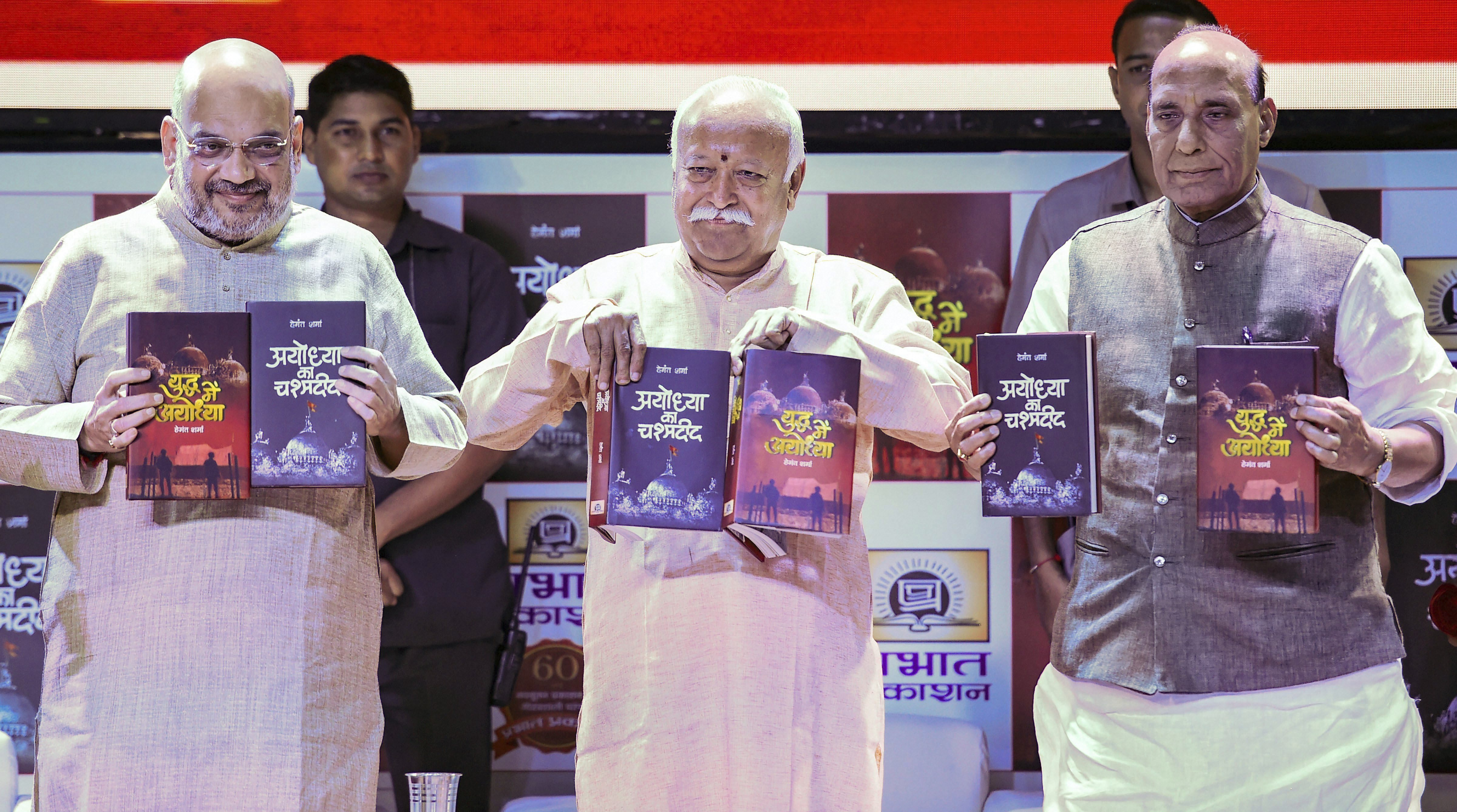 Union Home Minister Rajnath Singh, BJP National President Amit Shah and RSS chief Mohan Bhagwat release the books