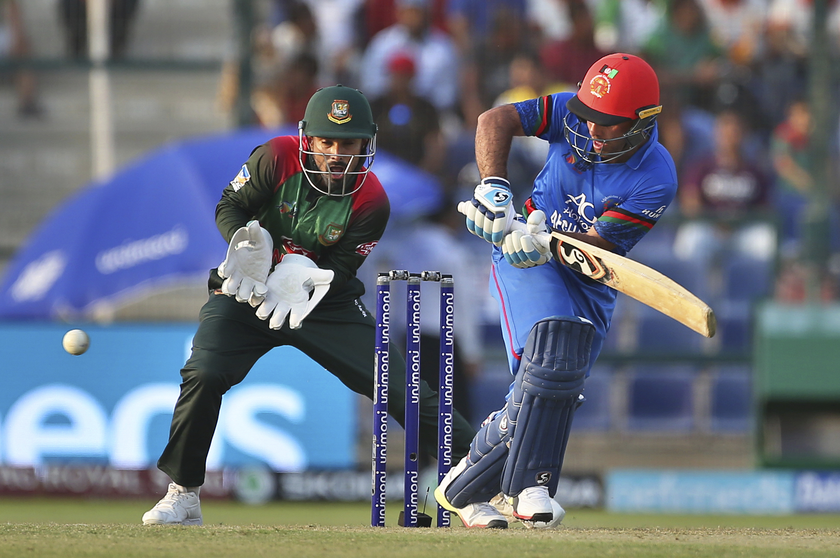 Afghanistan's Hashmatullah Shahidi, right bats during the one day international cricket match of Asia Cup between Bangladesh and Afghanistan in Abu Dhabi, United Arab Emirates - AP