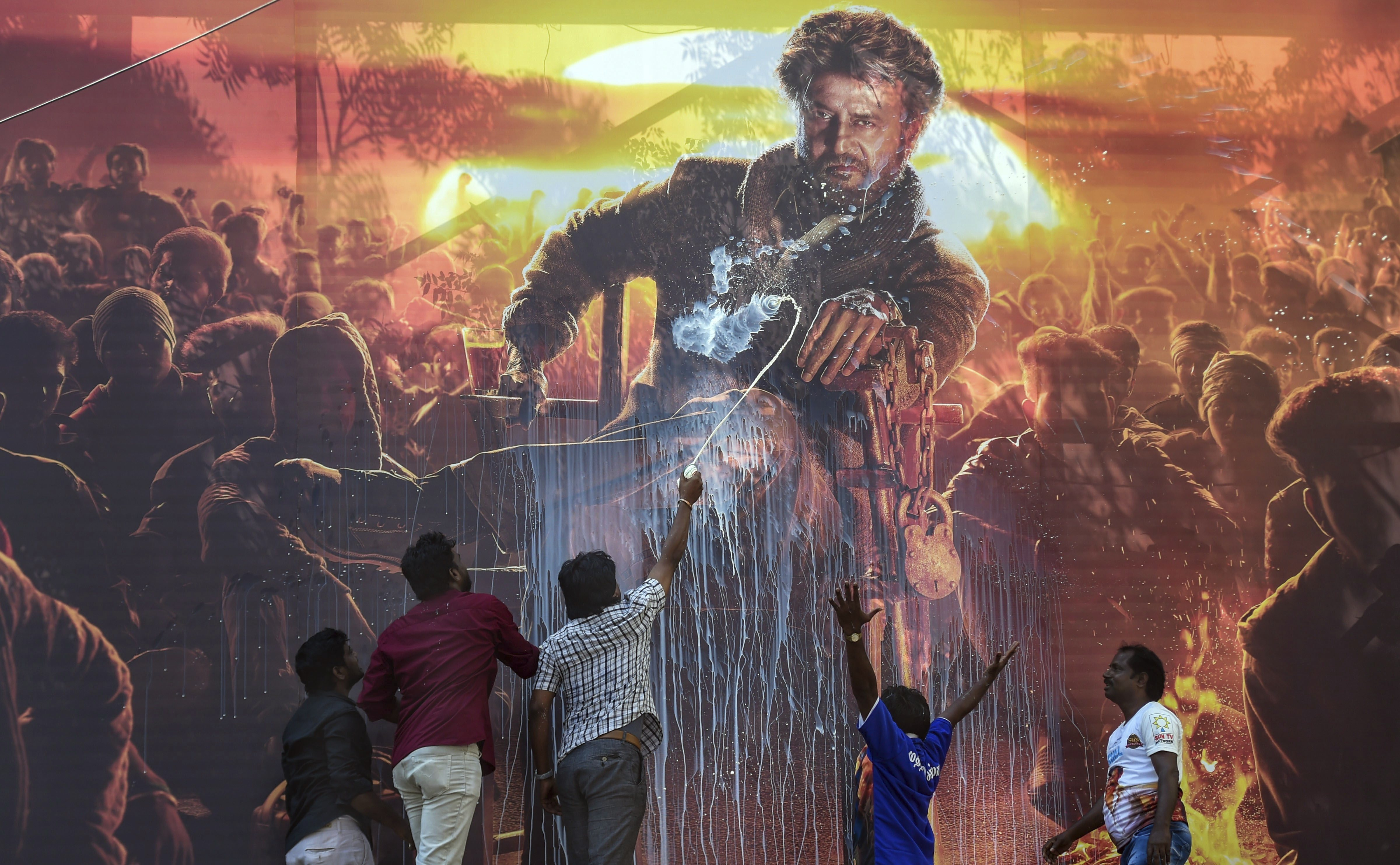 Rajnikanth fans celebrate the release of his film 'Petta' at a theater, in Chennai - PTI