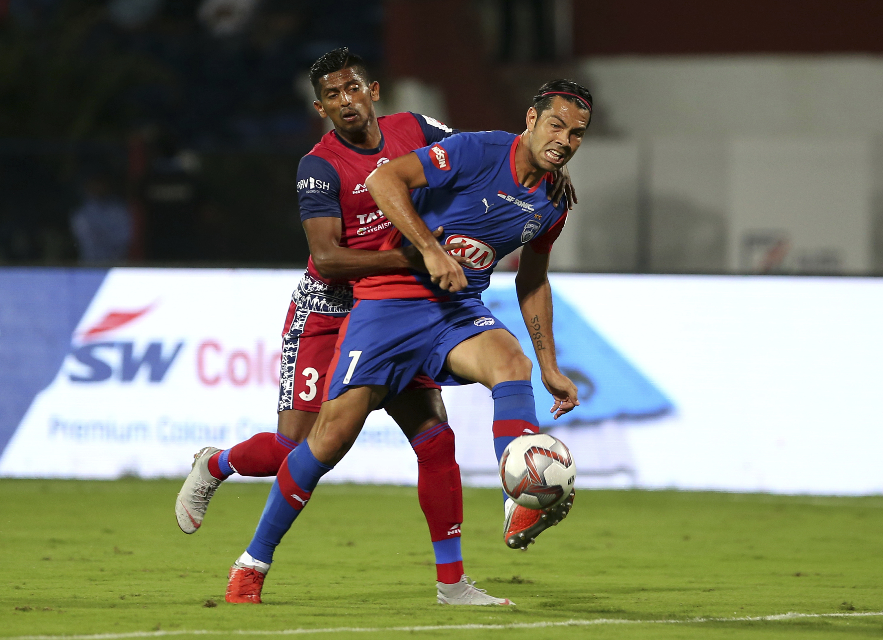 Nicolas Fedor, right, of Bengaluru FC and Raju Gaikwad of Jamshedpur FC fight for the ball during the Hero Indian Super League (ISL) soccer match between Bengaluru FC and Jamshedpur FC in Bangalore - AP
