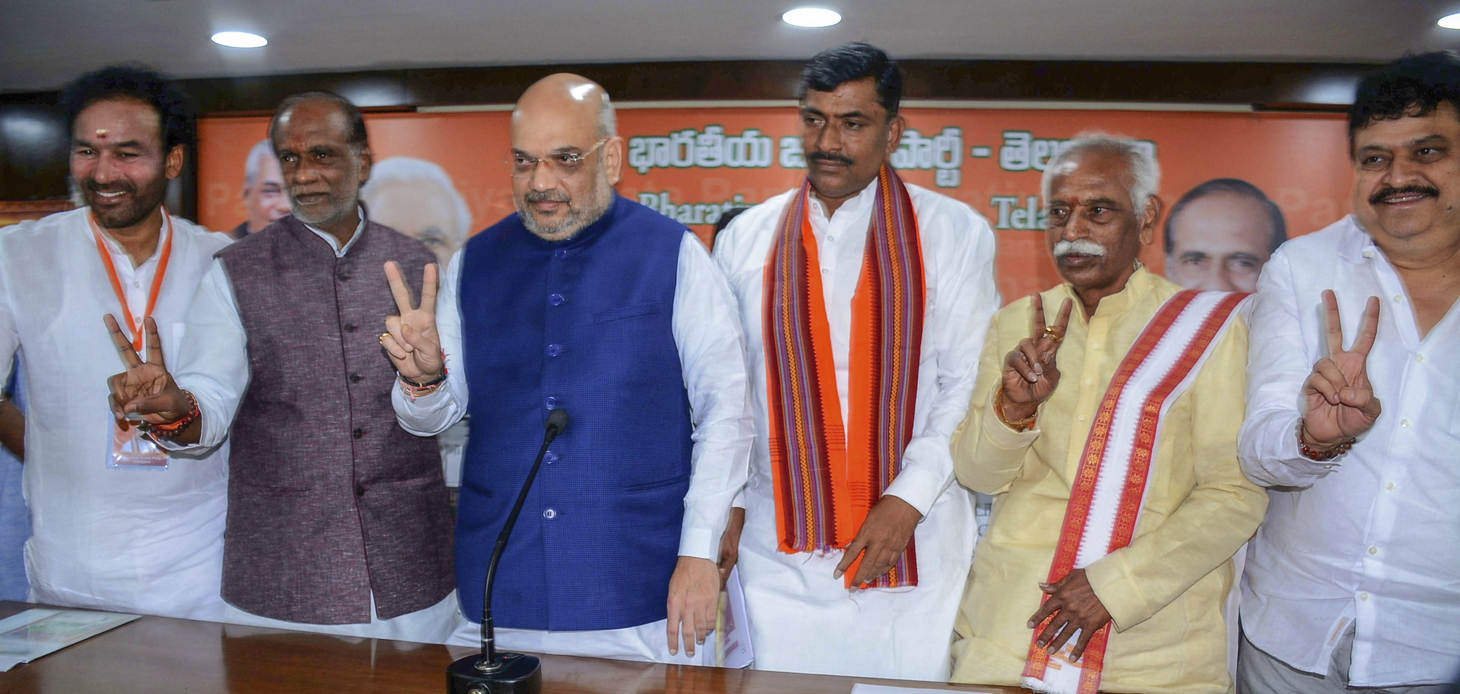 BJP National President Amit Shah with Telangana Party President DR Lakshman and others pose for photos after a press conference, in Hyderabad - PTI