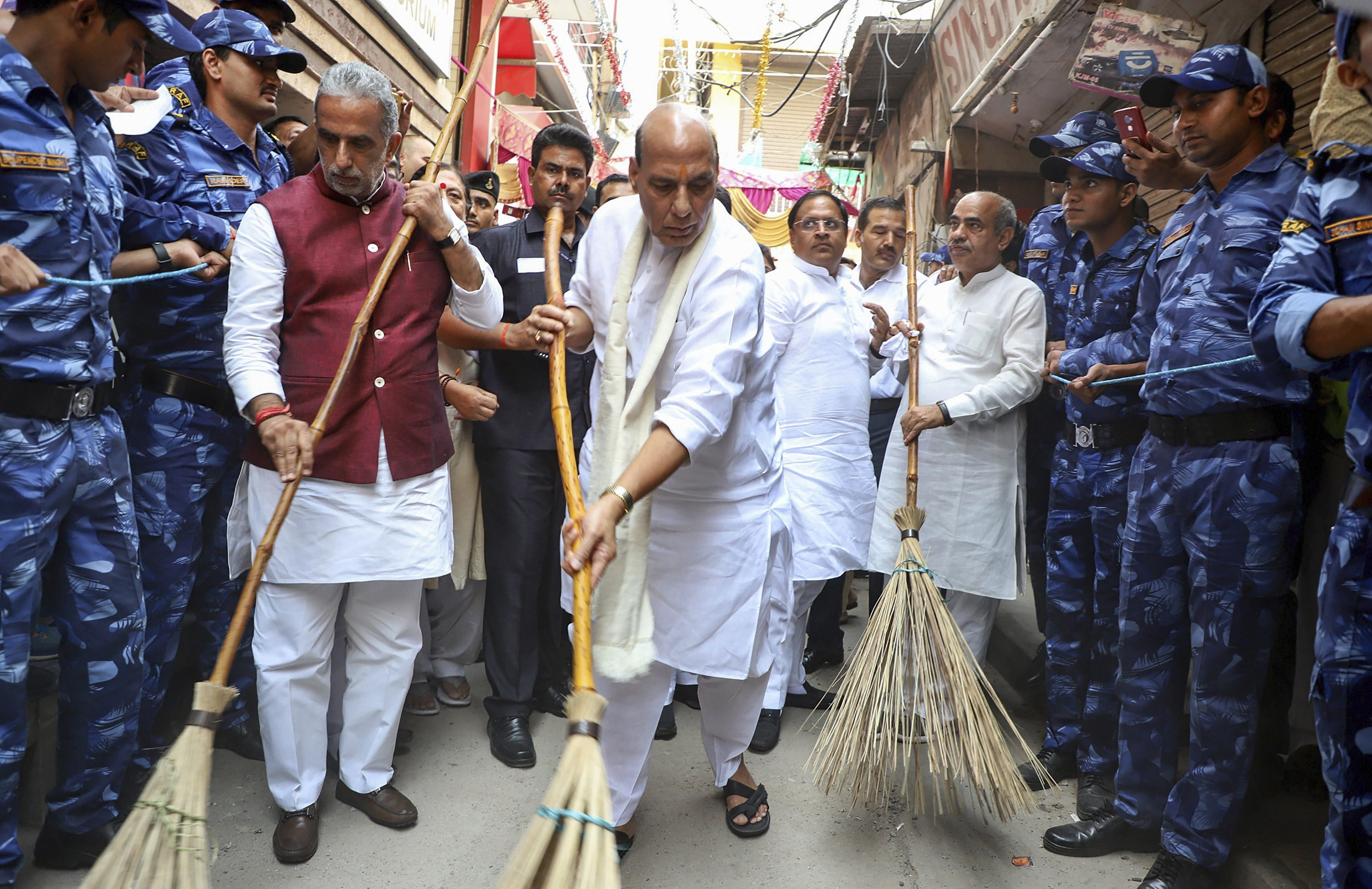 Union Home Minister Rajnath Singh with Minister of State for Social Justice & Empowerment Krishan Pal during a cleanliness drive under 'Swachhta Hi Sewa' campaign, in Faridabad - PTI