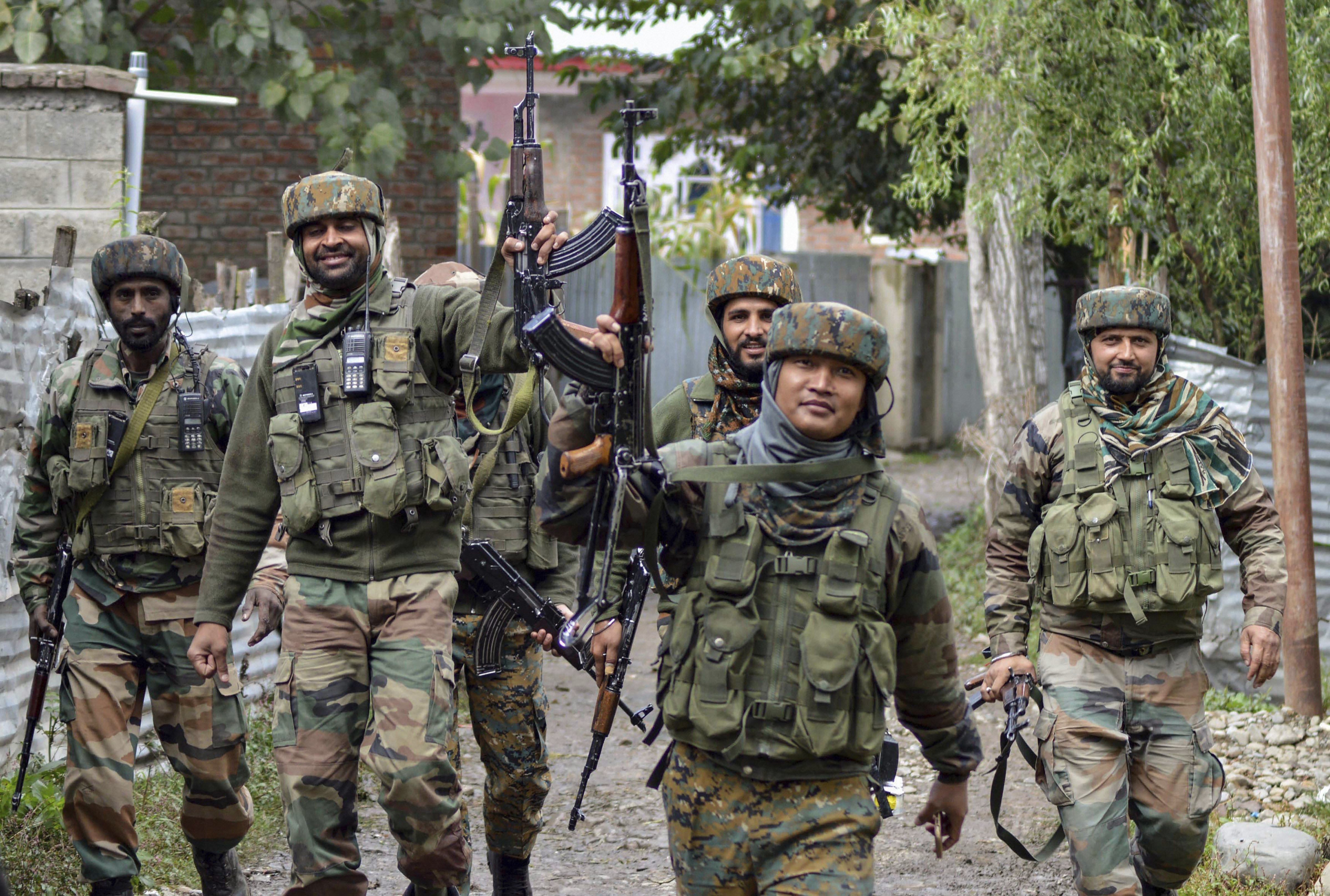 Army soldiers celebrates after the killing of five Hizbul Mujahideen and Lashkar-e-Taiba militants including top HM Commander Gulzar Paddar ,at Chowgam area of Qazigund in Kulgam district of south Kashmir - PTI
