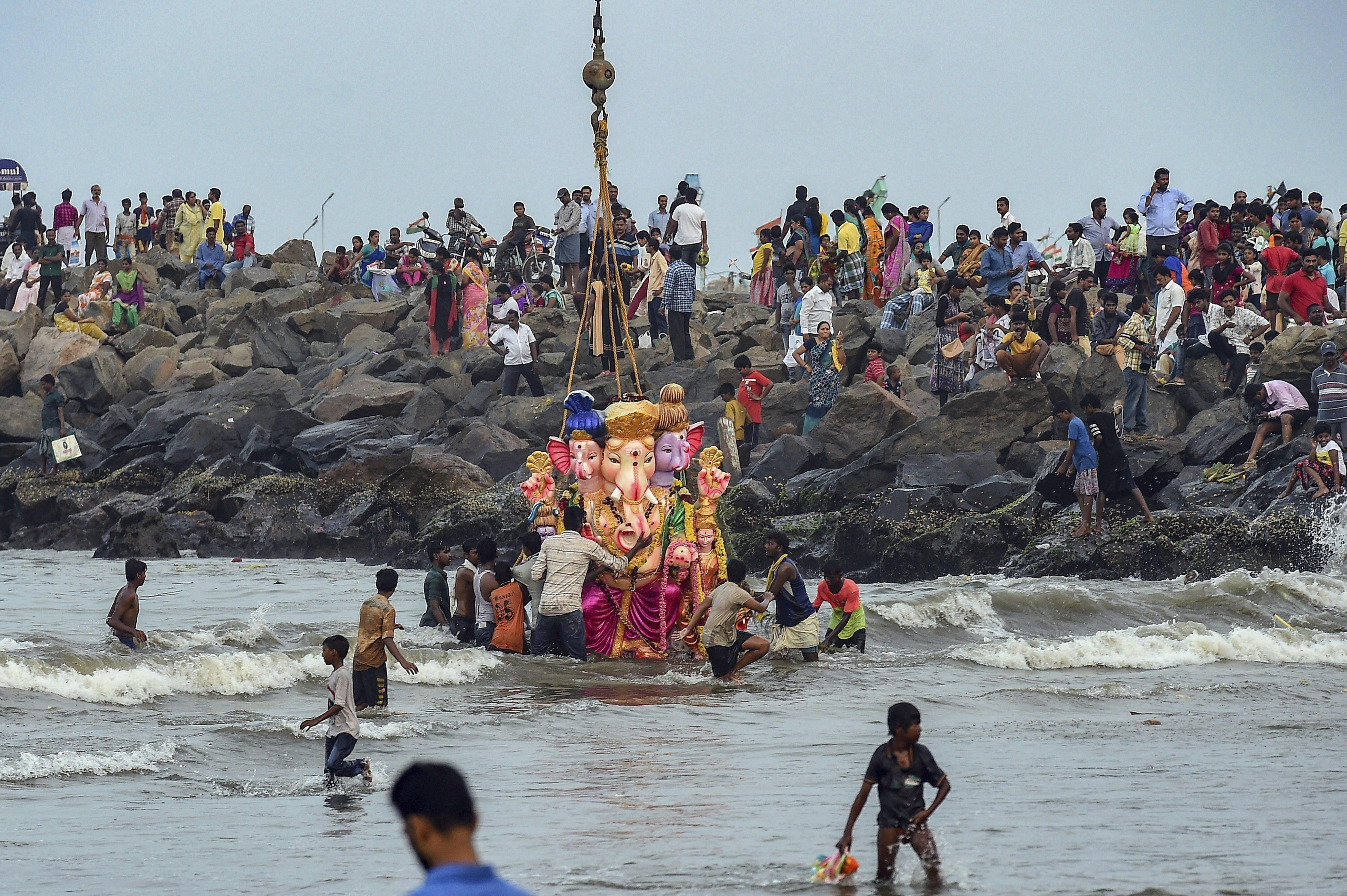 People participate in immersion of Gnanesh idols following Ganesh Chaturthi celebrations, in Bay of Bengal near Ennore Fishing harbour, in Chennai - PTI