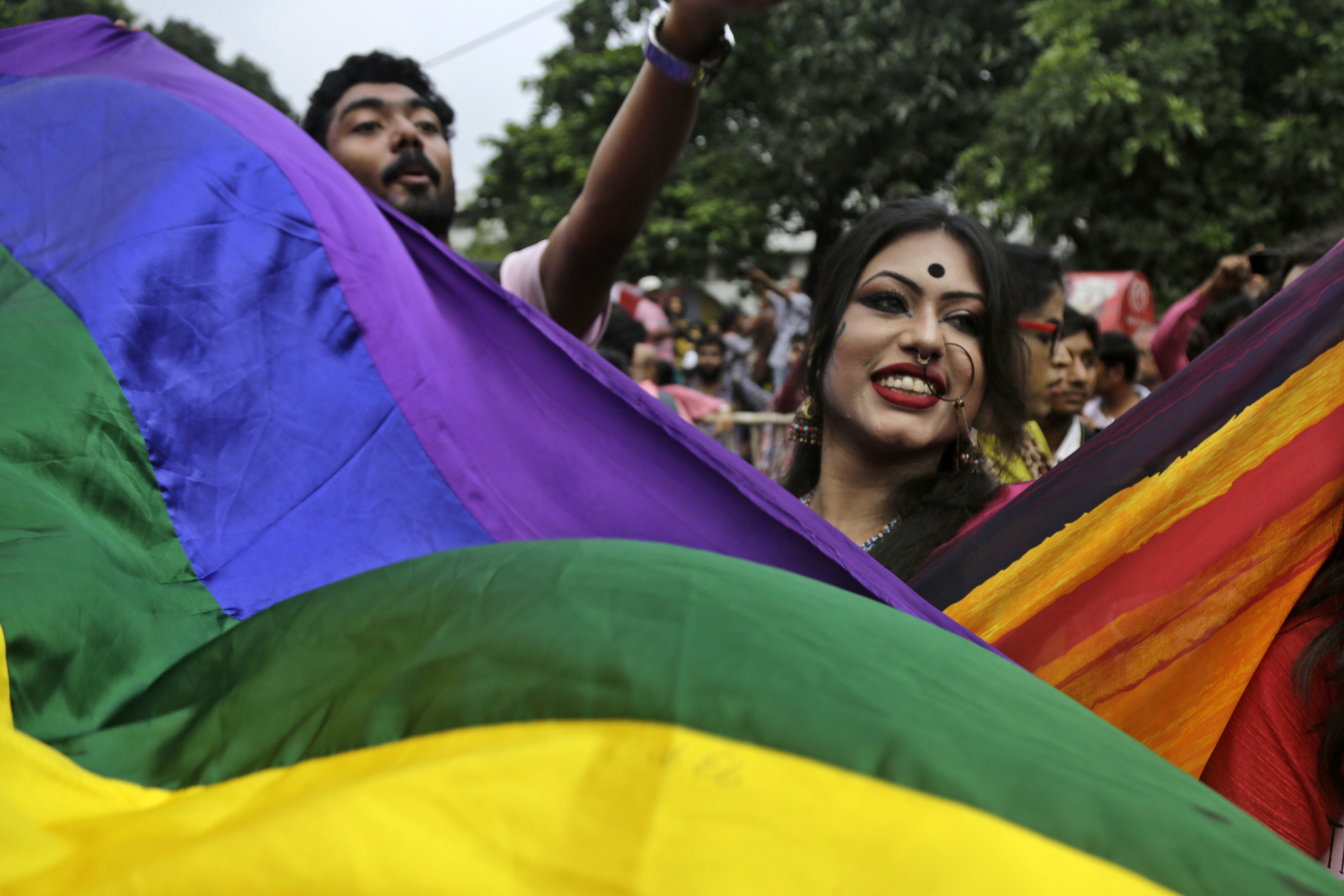 Gay rights activists join a pride rally celebrating victory over a colonial criminal law in Kolkata, India - AP