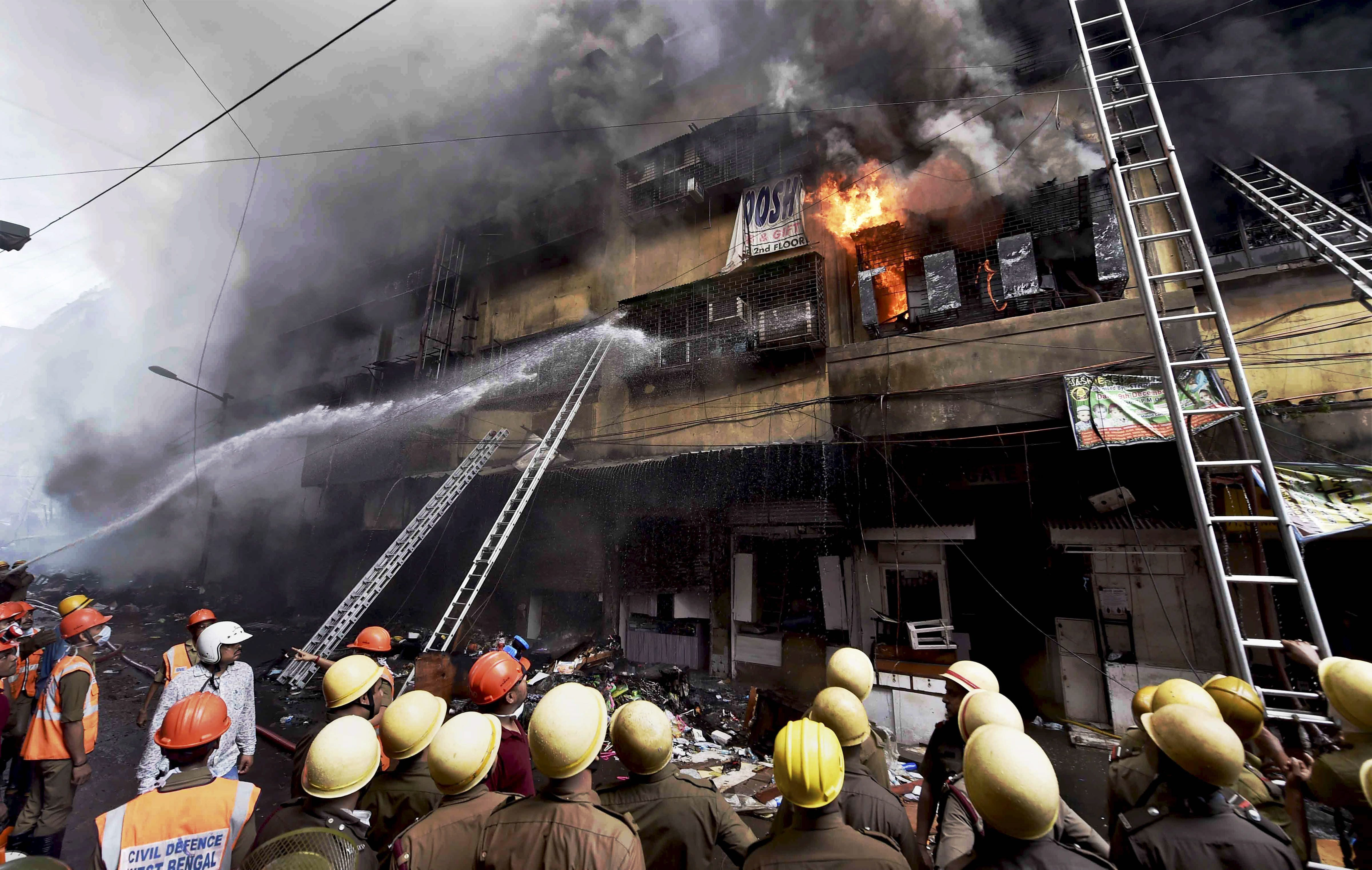 Firefighters try to douse a fire that broke out in a multi-storied wholesale Bagree market, at Burrabazar in Kolkata - PTI