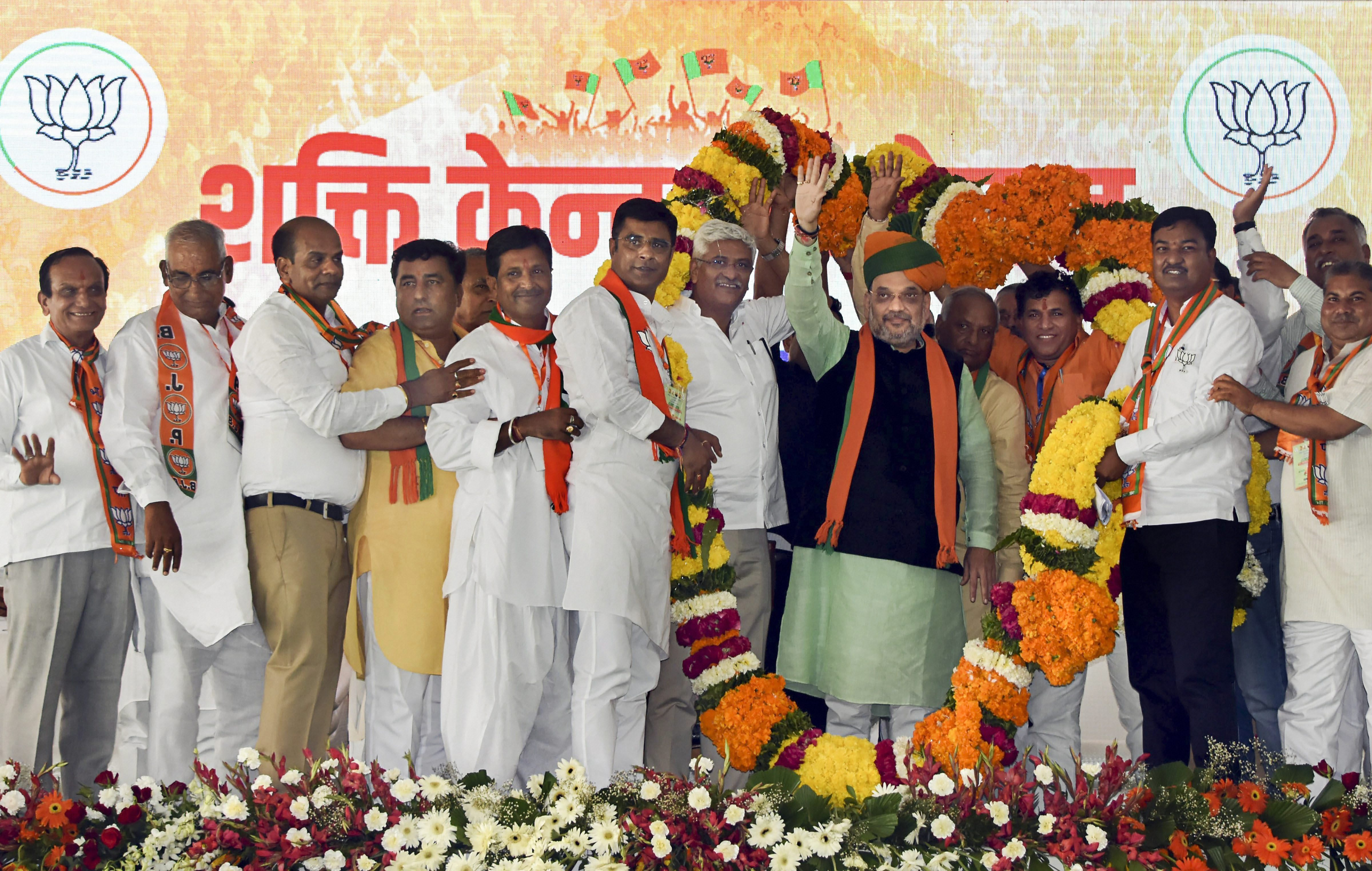 BJP National President Amit Shah is greeted by State President Madan Lal Saini and party MP's, in Jodhpur - PTI