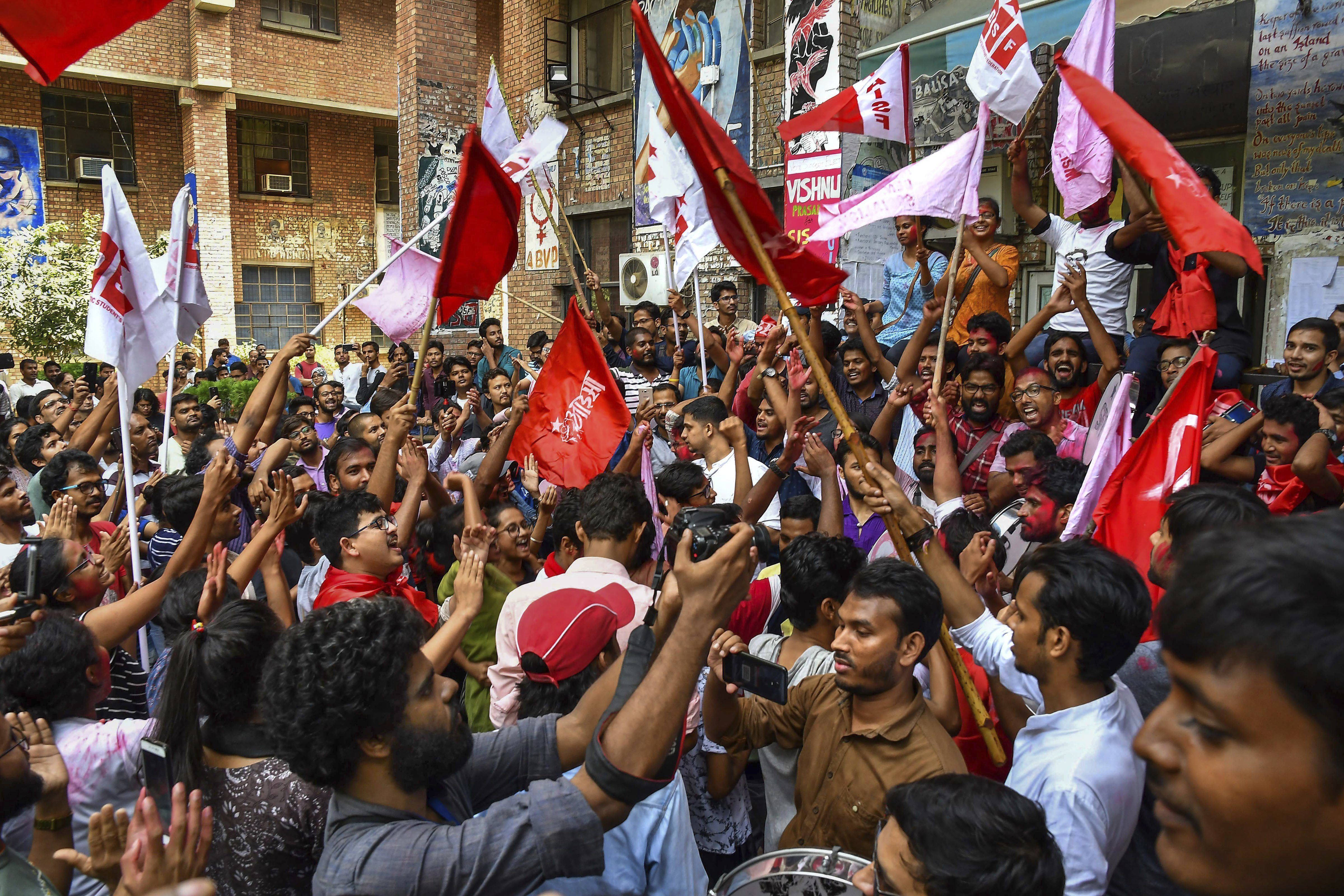 Members of Left Unity celebrate after their sucess in Jawaharlal Nehru University Student Union (JNUSU) elections, in New Delhi - PTI