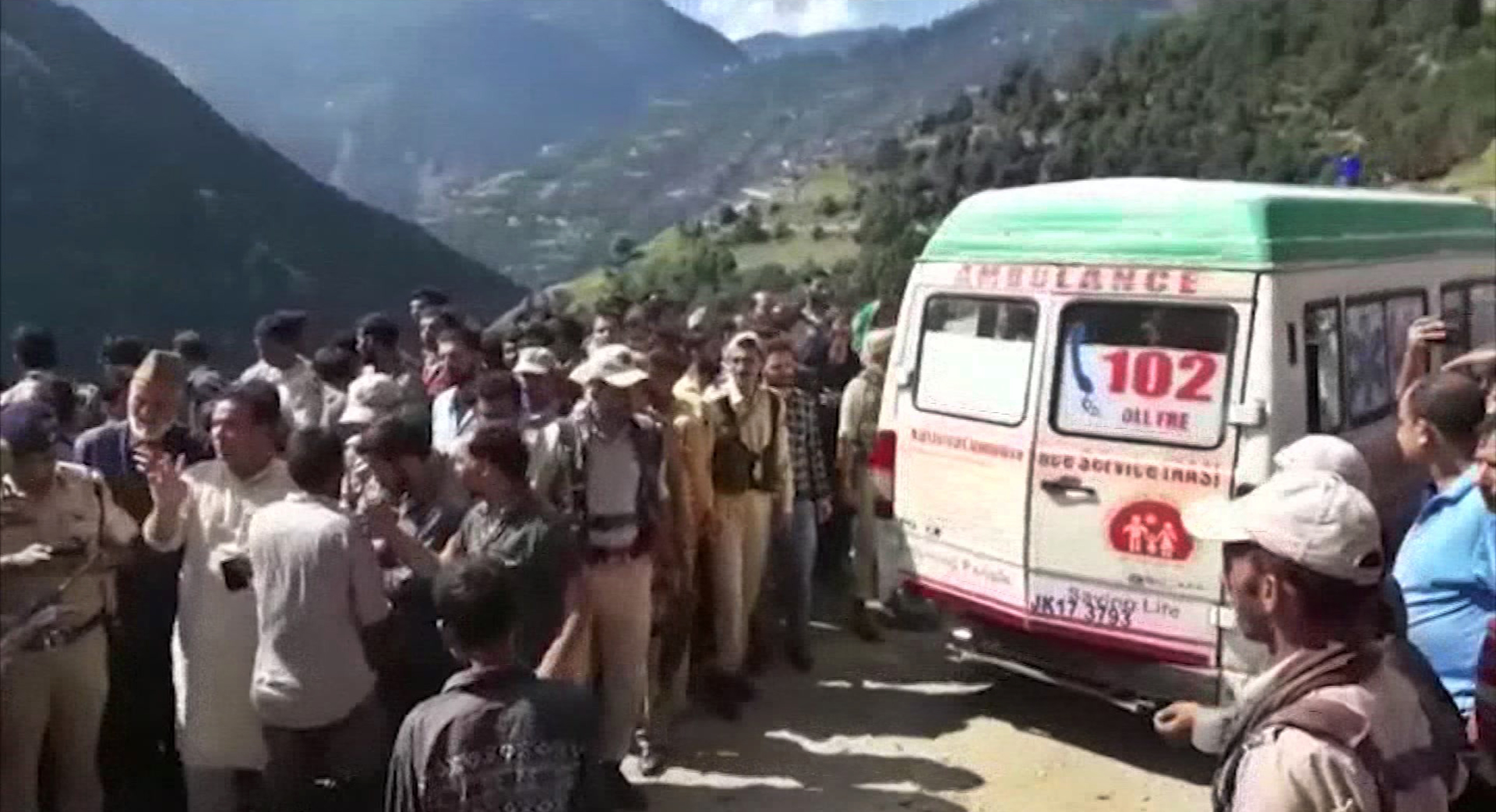 In this grab made from video provided by KK Productions, an ambulance waits to transport people injured in a bus accident in Kishtwar - AP