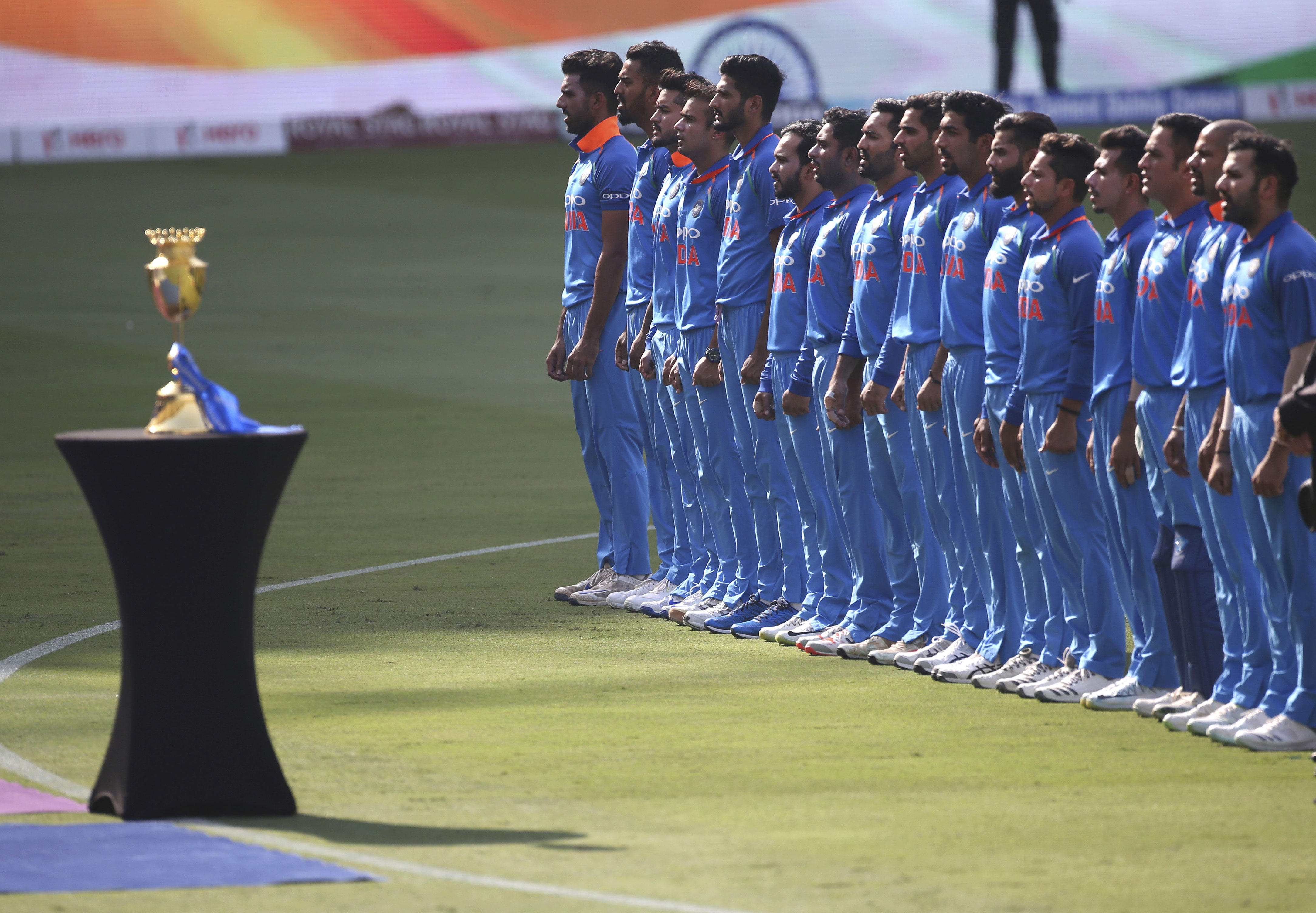 Members of the Indian team stand for their national anthem before the start of the final one day international cricket match of Asia Cup between India and Bangladesh, in Dubai, United Arab Emirates - AP