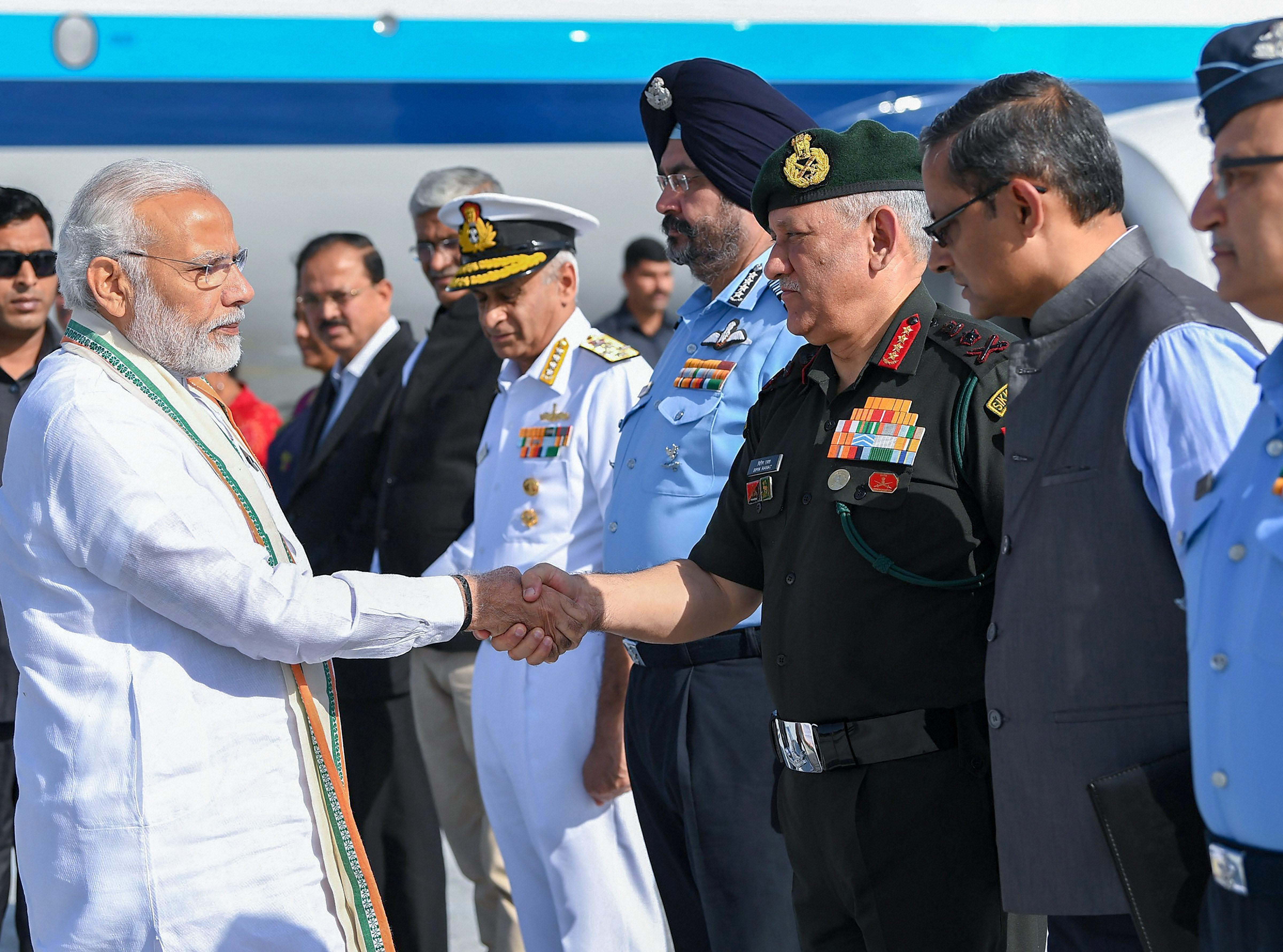 Prime Minister Narendra Modi shakes hands with Army Chief General Bipin Rawat on his arrival to attend 'Parakram Parv' celebrations, in Jodhpur - PTI