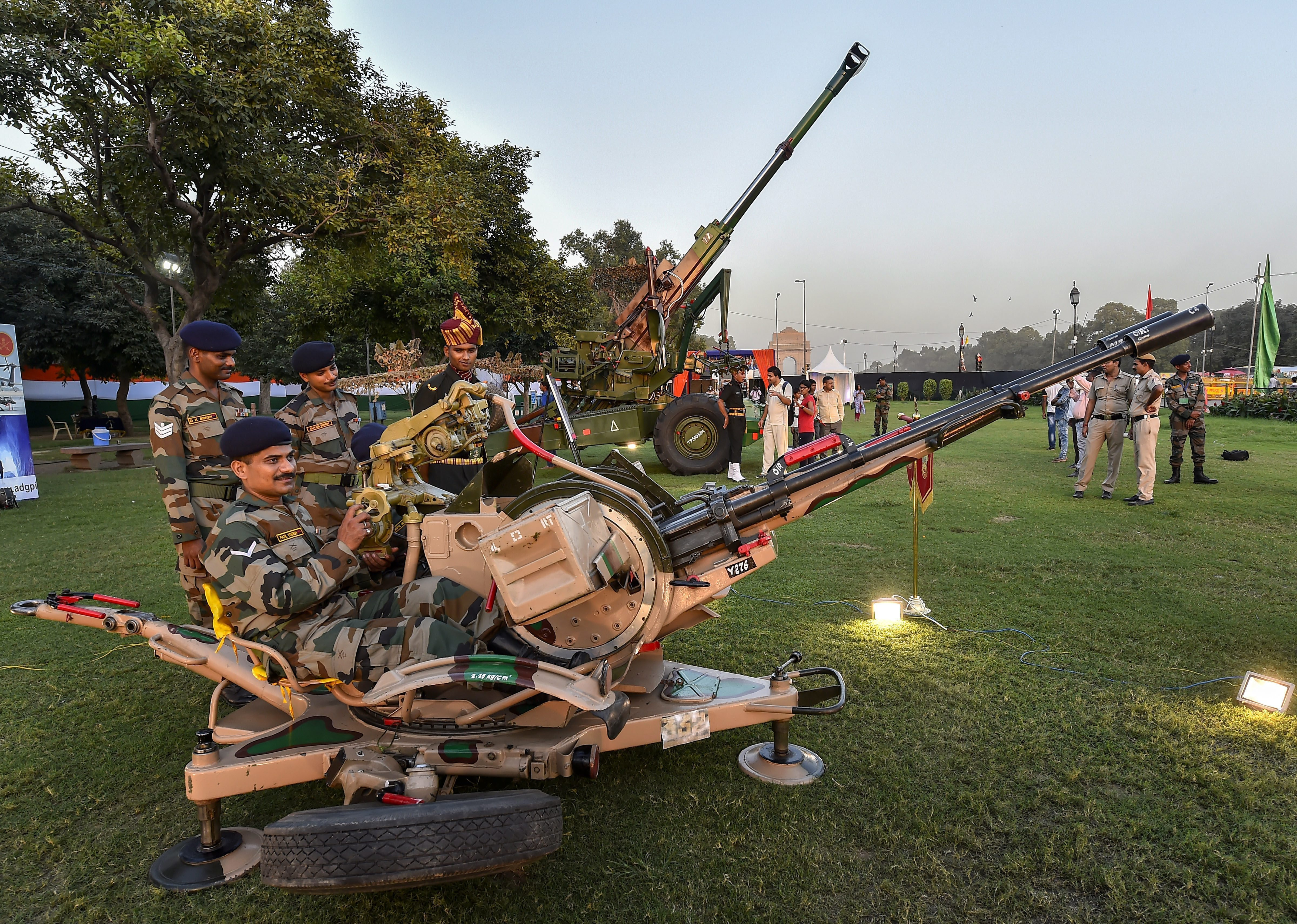 Army personnel pose withan exhibit during the inauguration of 'Parakram Parv', at India Gate Lawns in New Delhi - PTI