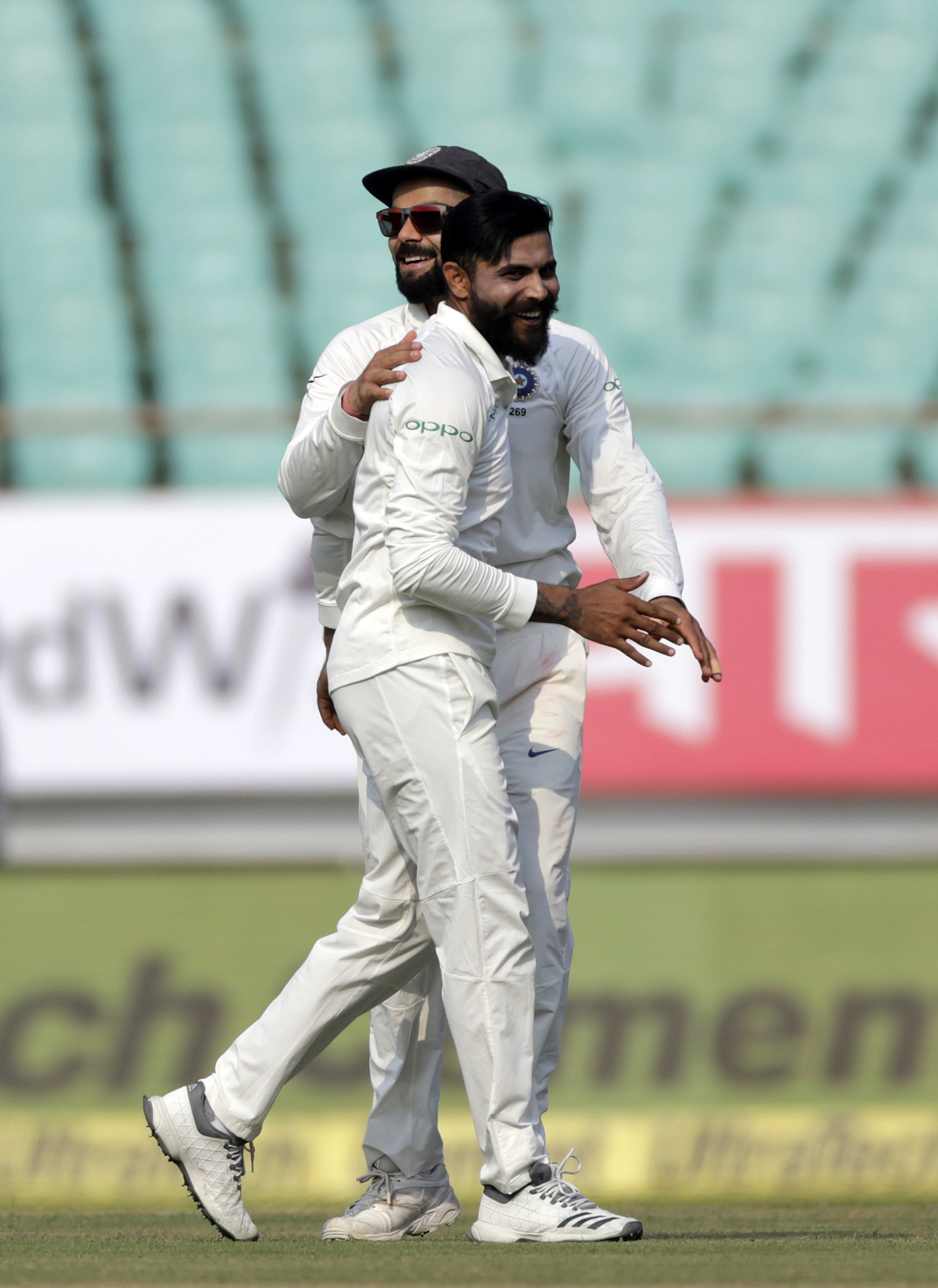Indian cricketer Ravindra Jadeja celebrates after dismissin West Indies' Sunil Ambris during the second day of the first cricket test match between India and West Indies in Rajkot - AP